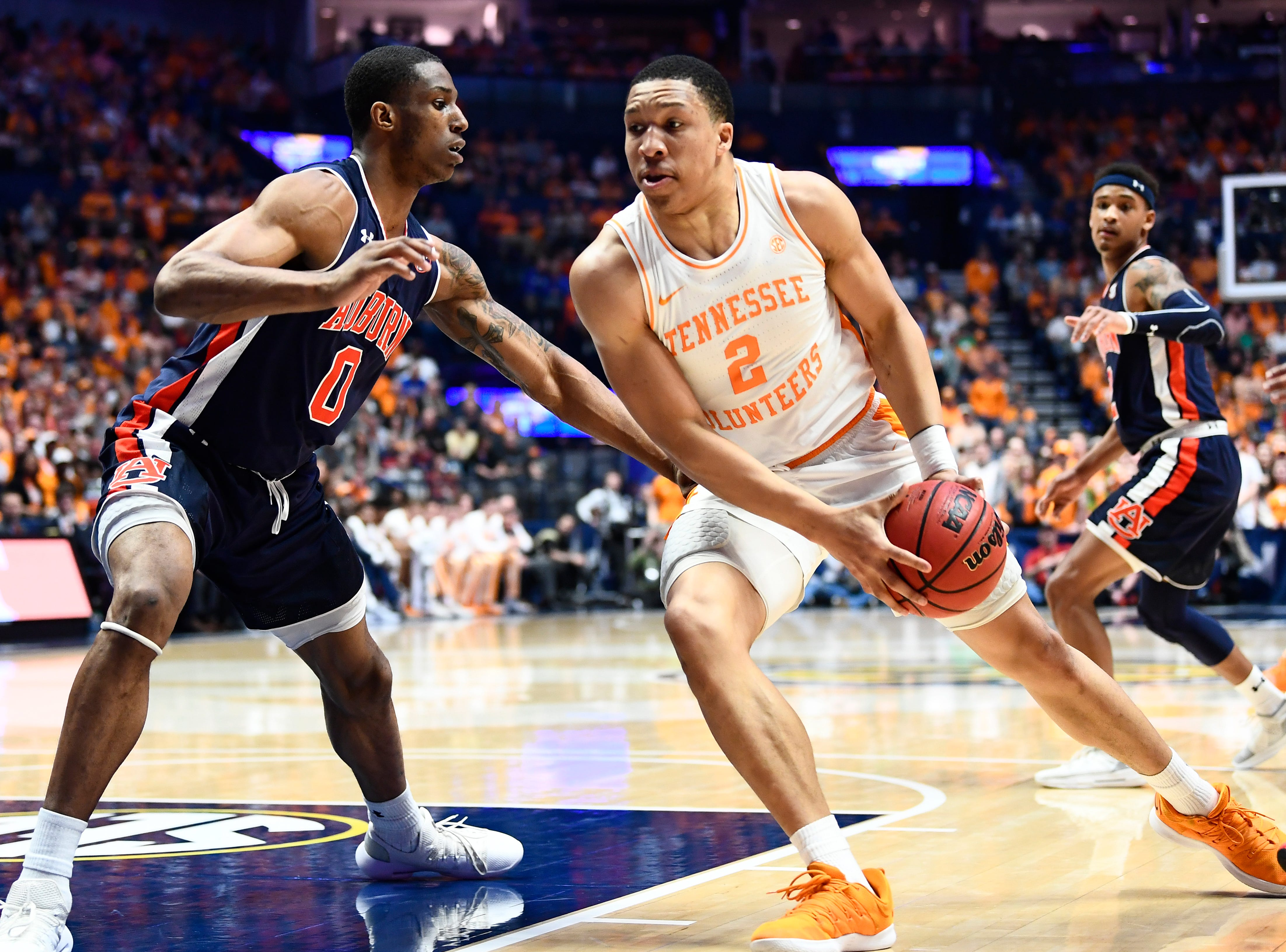 Tennessee forward Grant Williams (2) is defended by Auburn forward Horace Spencer (0) during the first half of the SEC Men's Basketball Tournament championship game at Bridgestone Arena in Nashville, Tenn., Sunday, March 17, 2019.