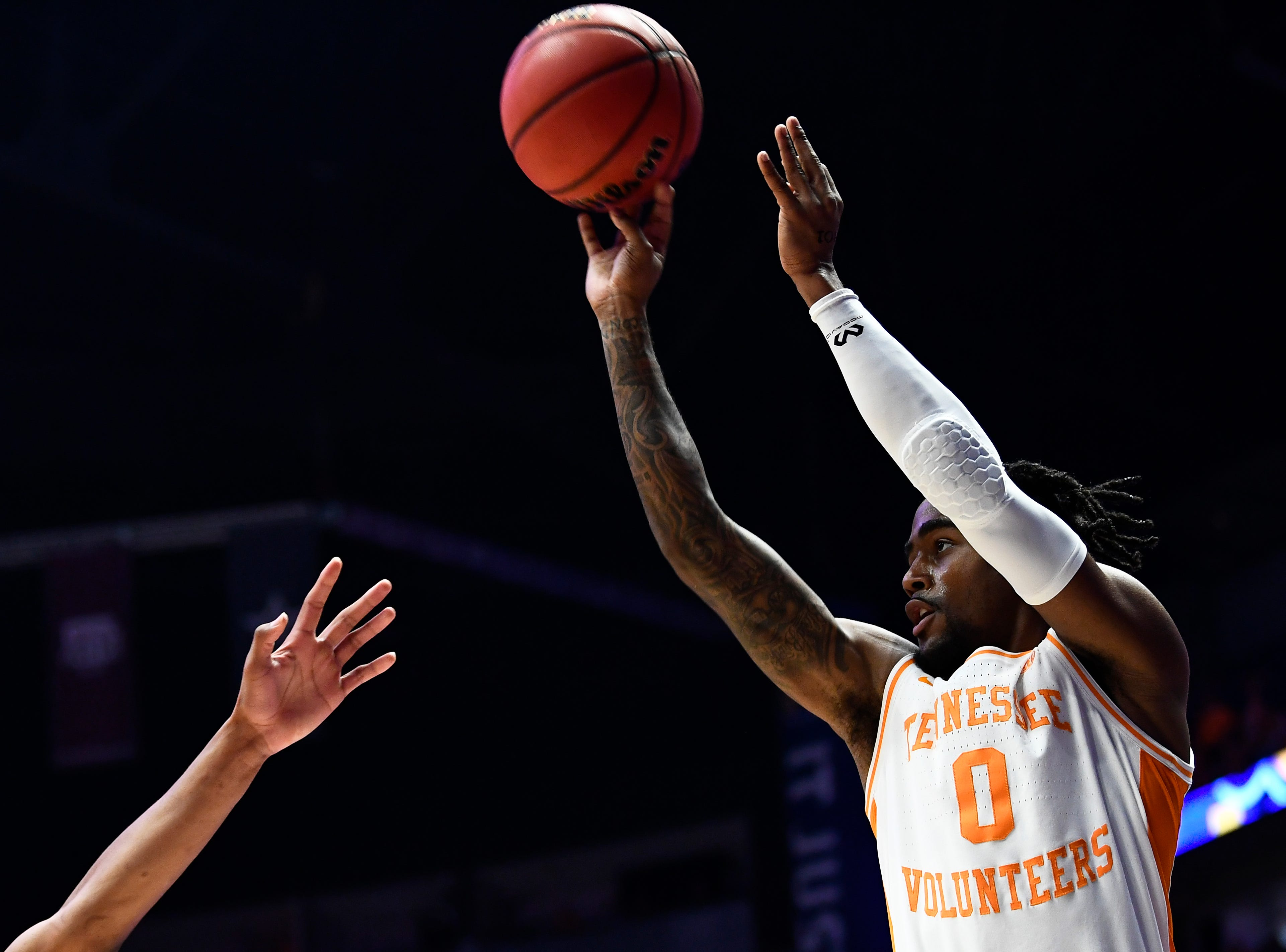 Tennessee guard Jordan Bone (0) takes a shot during the first half of the SEC Men's Basketball Tournament championship game at Bridgestone Arena in Nashville, Tenn., Sunday, March 17, 2019.