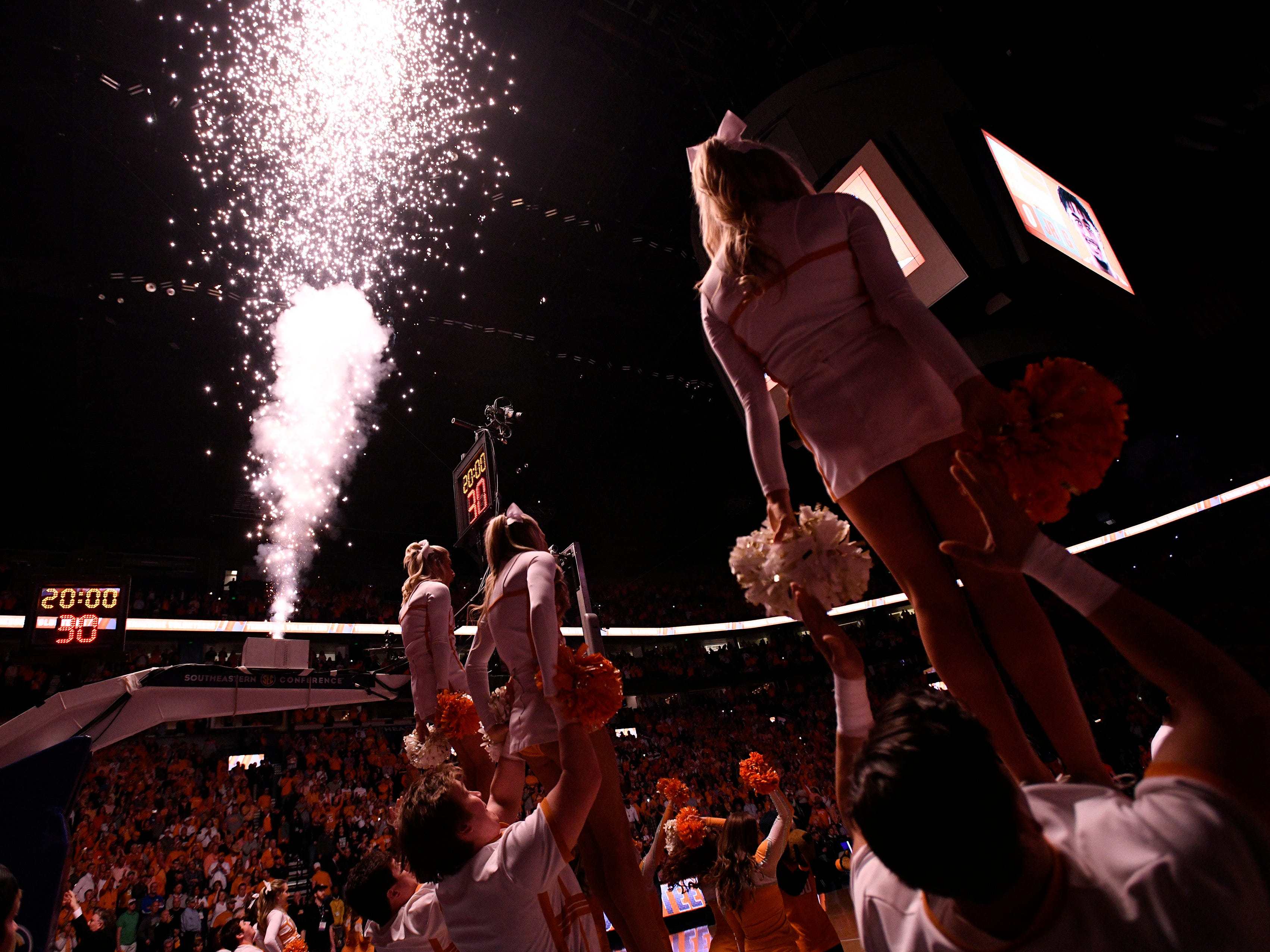 Tennessee cheerleaders lead the crowd before the start of the SEC Men's Basketball Tournament championship game against Auburn at Bridgestone Arena in Nashville, Tenn., Sunday, March 17, 2019.