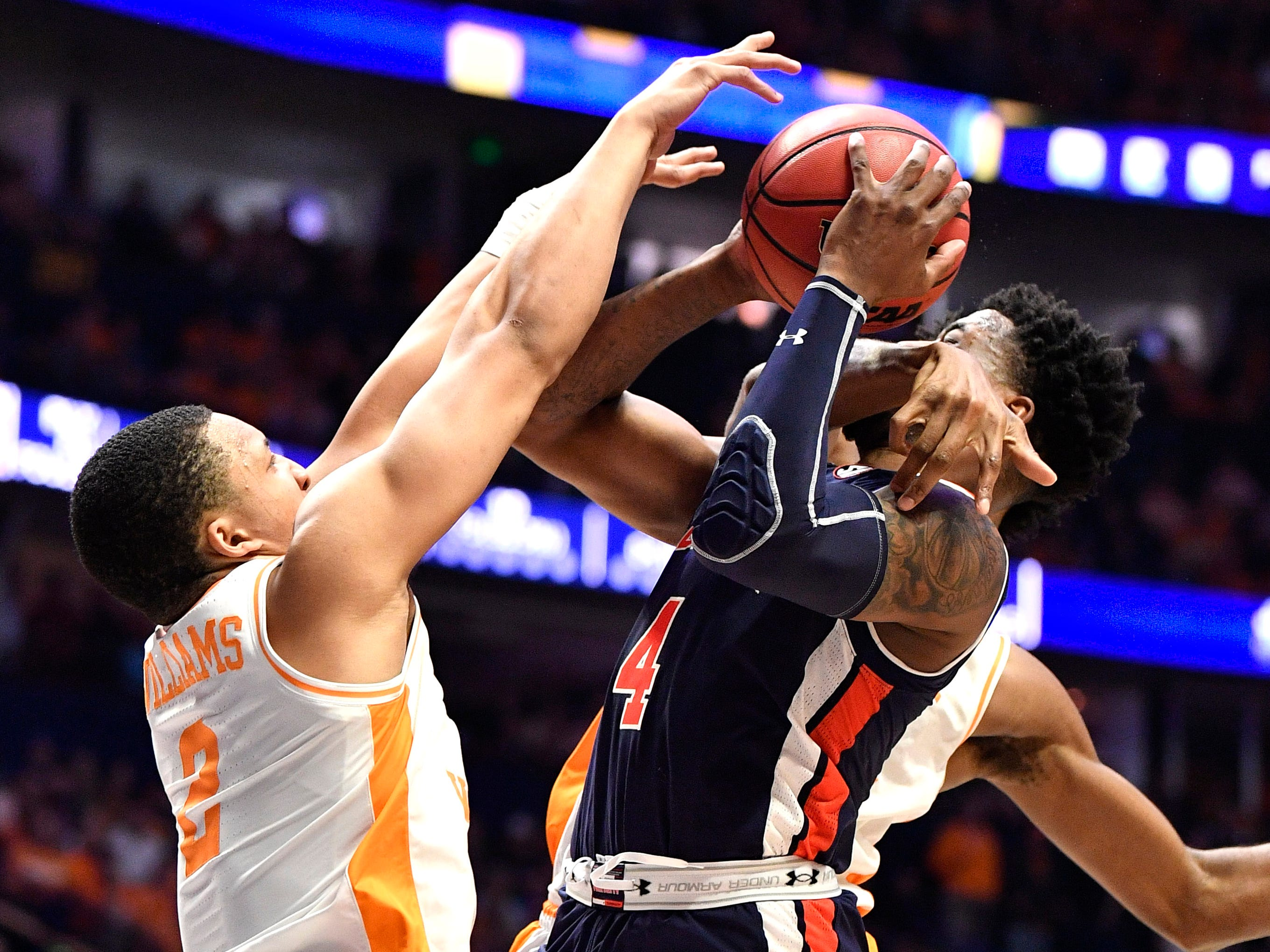 Auburn guard/forward Malik Dunbar (4) tries to take a shot defended by Tennessee forward Grant Williams (2) and forward Kyle Alexander (11) during the first half of the SEC Men's Basketball Tournament championship game at Bridgestone Arena in Nashville, Tenn., Sunday, March 17, 2019.