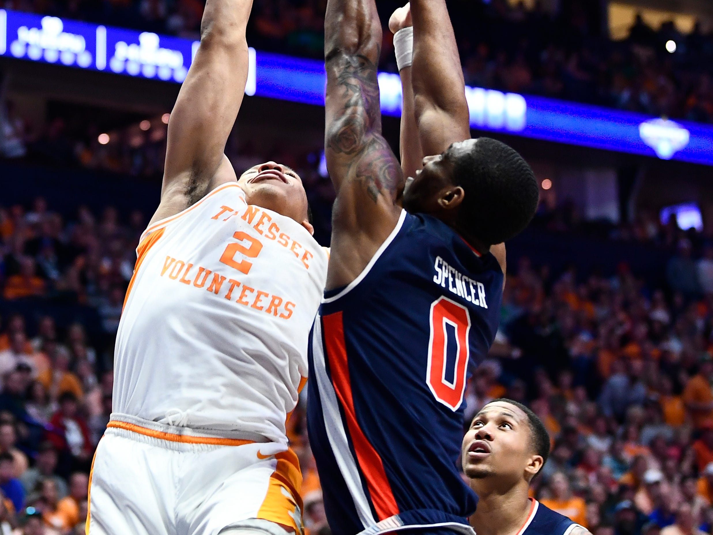 Tennessee forward Grant Williams (2) attempts a shot while defended by Auburn forward Horace Spencer (0) during the first half of the SEC Men's Basketball Tournament championship game at Bridgestone Arena in Nashville, Tenn., Sunday, March 17, 2019.