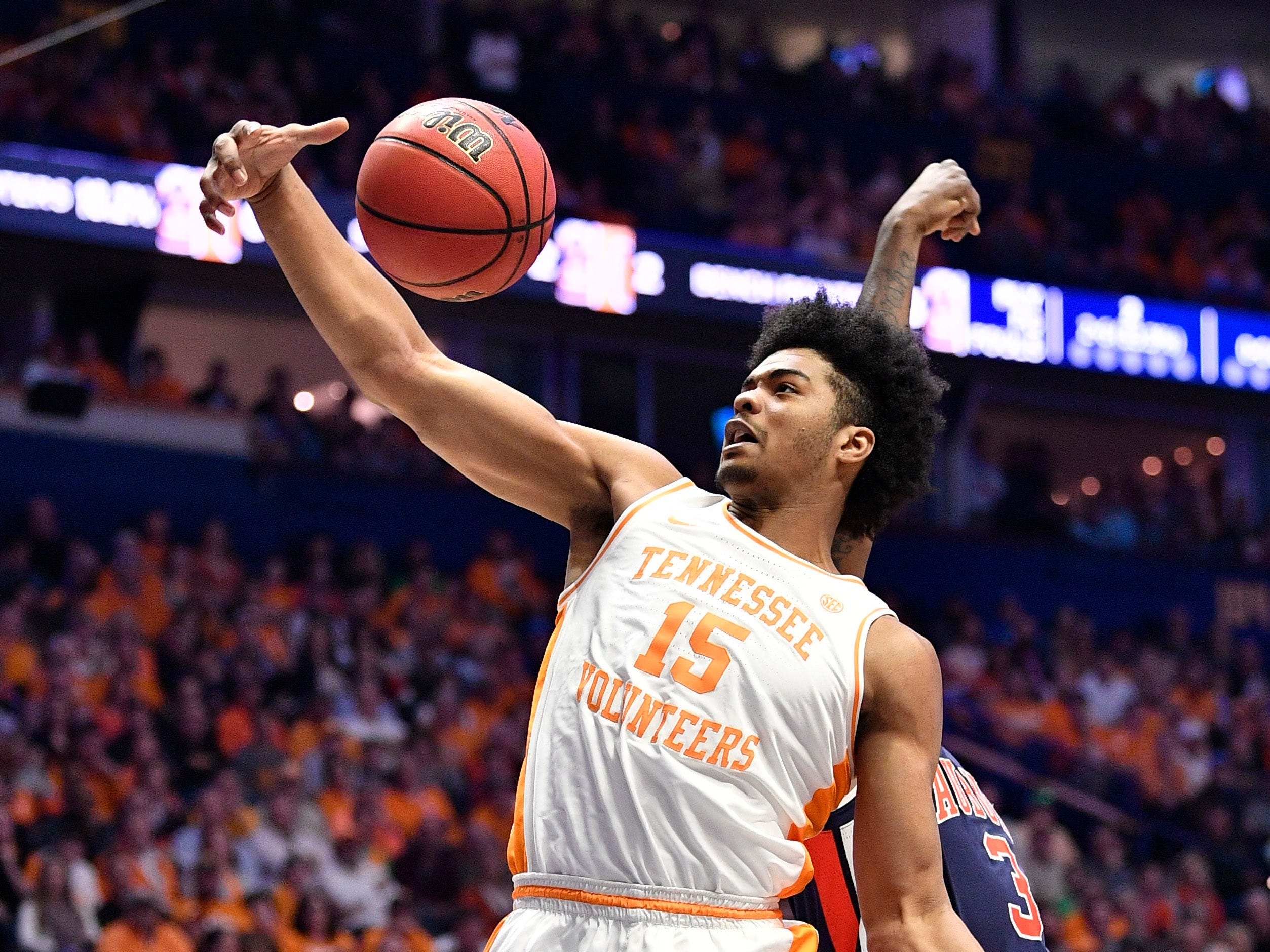 Tennessee forward Derrick Walker (15) grabs a rebound during the first half of the SEC Men's Basketball Tournament championship game at Bridgestone Arena in Nashville, Tenn., Sunday, March 17, 2019.