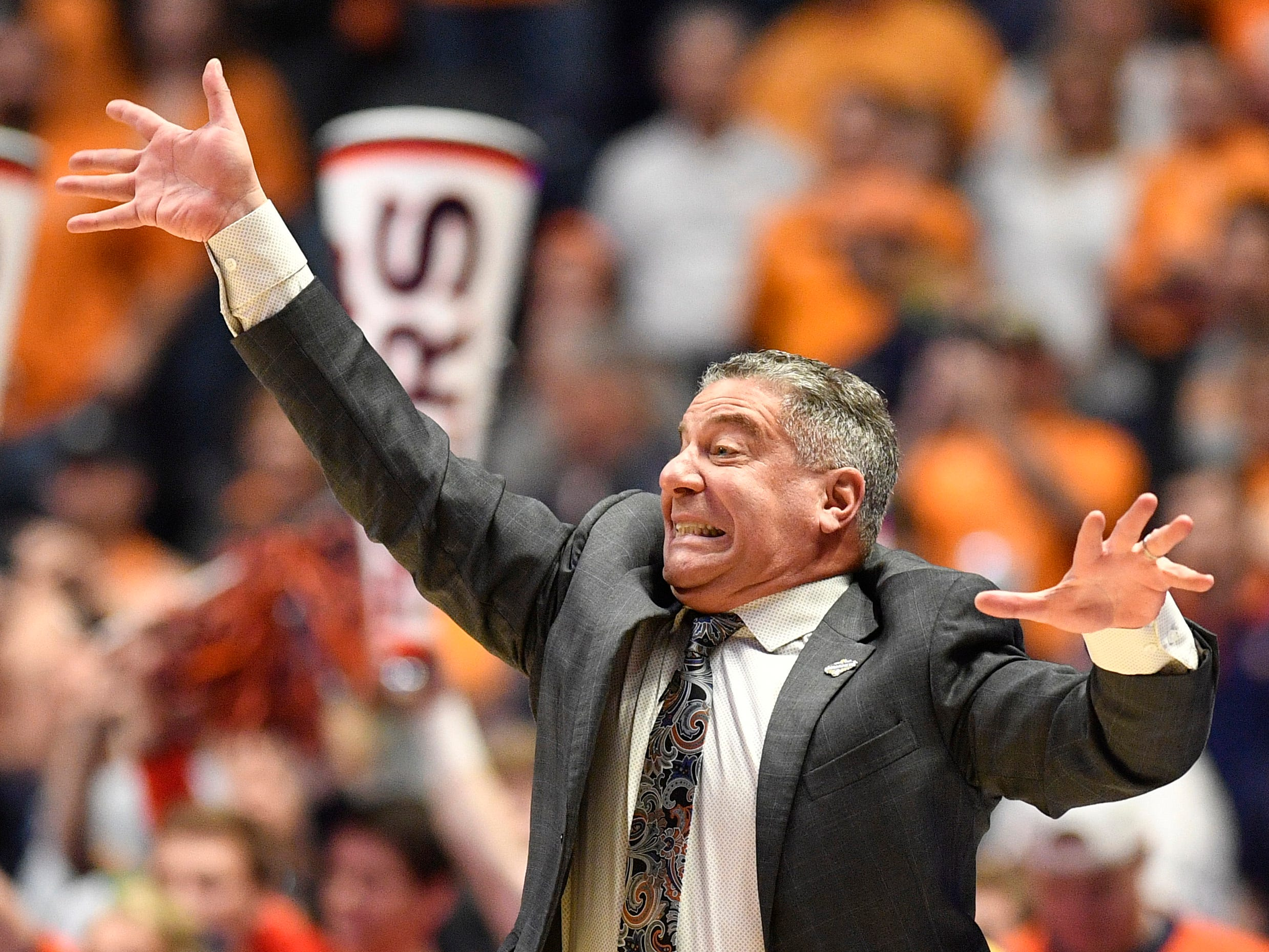 Auburn head coach Bruce Pearl gestures during the first during the first half of the SEC Men's Basketball Tournament championship game against Tennessee at Bridgestone Arena in Nashville, Tenn., Sunday, March 17, 2019.