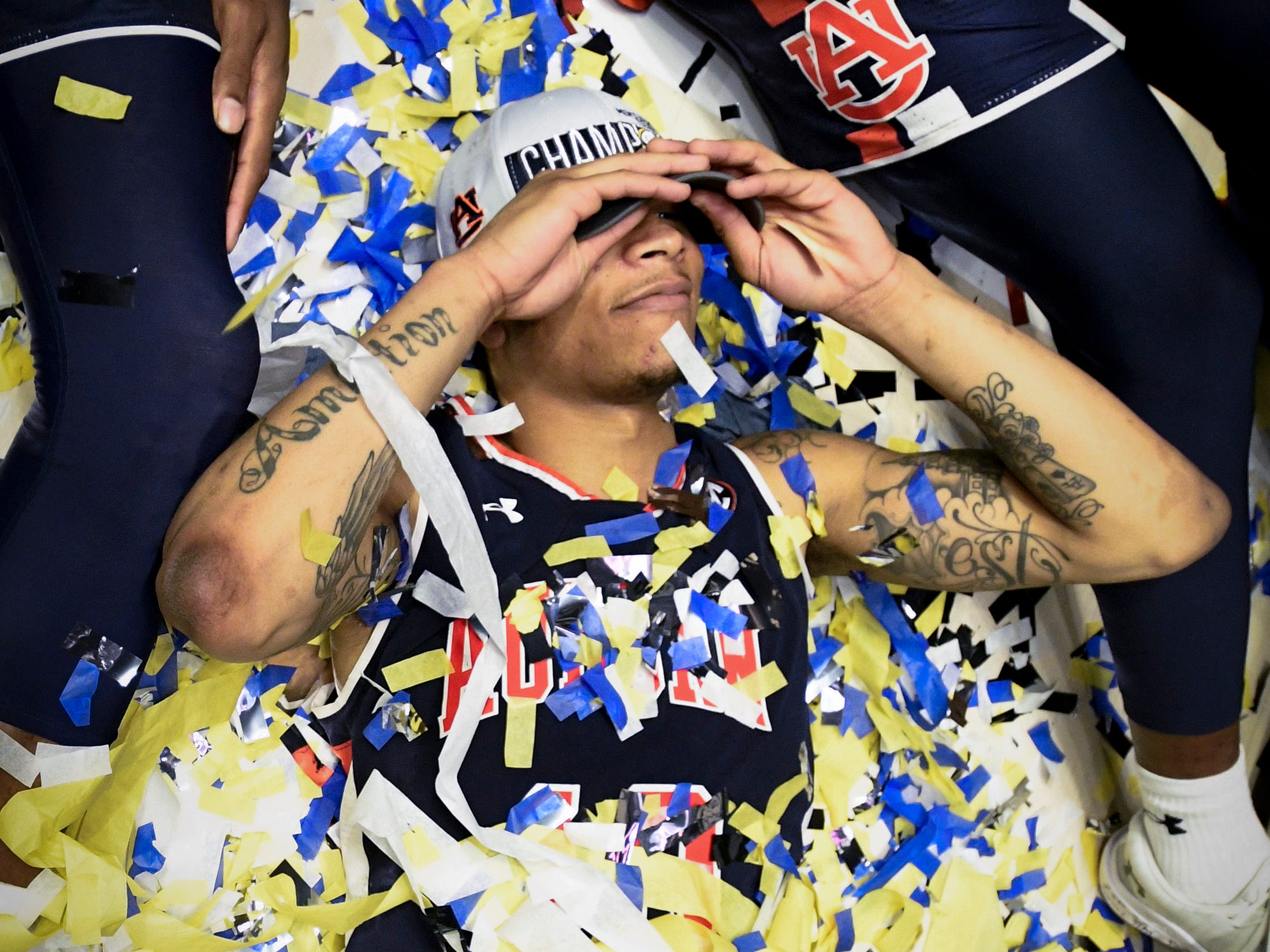 Auburn guard Samir Doughty (10) celebrates after their SEC Men's Basketball Tournament championship victory against Tennessee at Bridgestone Arena in Nashville, Tenn., Sunday, March 17, 2019.