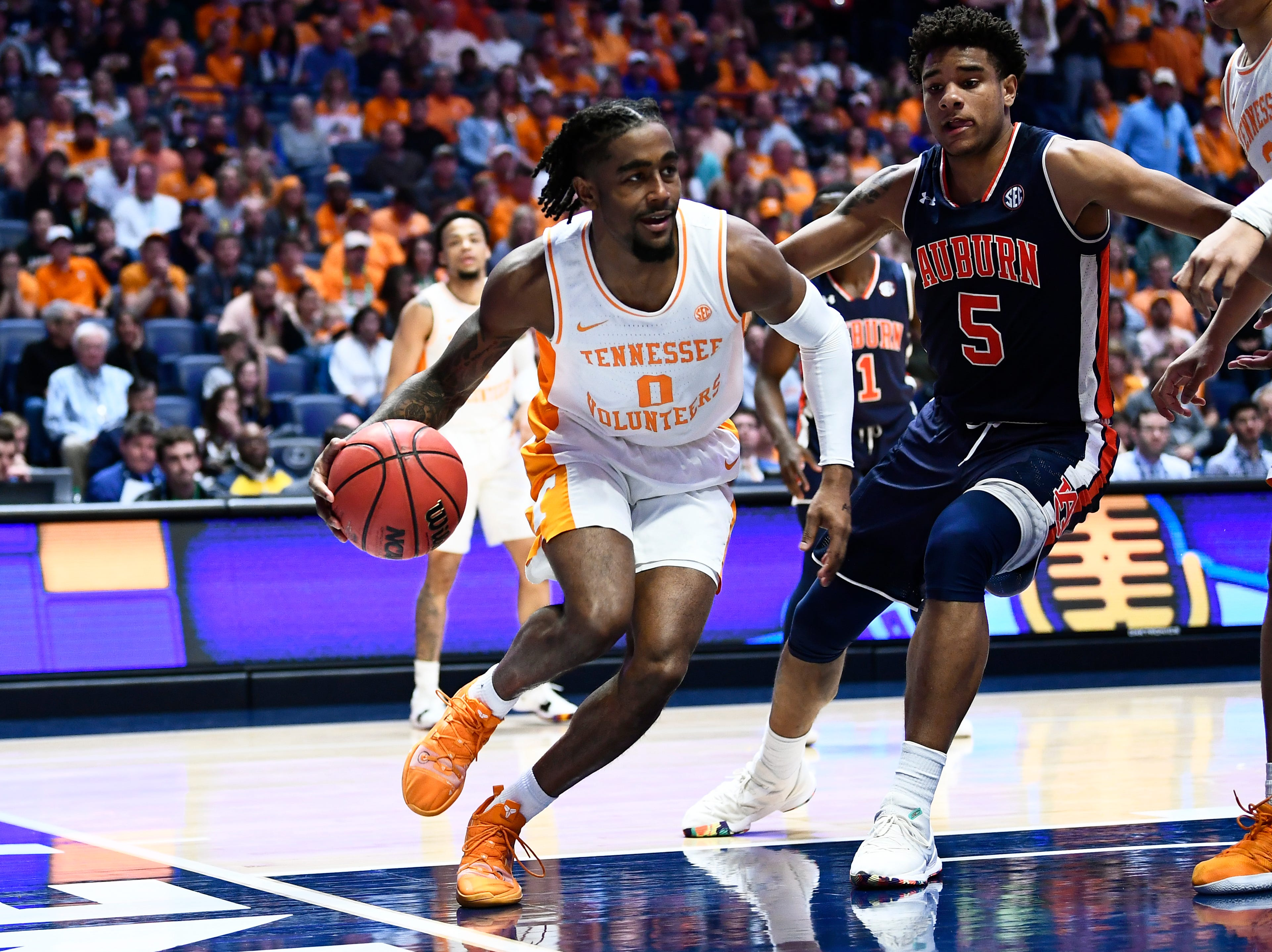 Tennessee guard Jordan Bone (0) drives towards the basket while defended by Auburn forward Chuma Okeke (5) during the second half of the SEC Men's Basketball Tournament championship game at Bridgestone Arena in Nashville, Tenn., Sunday, March 17, 2019.