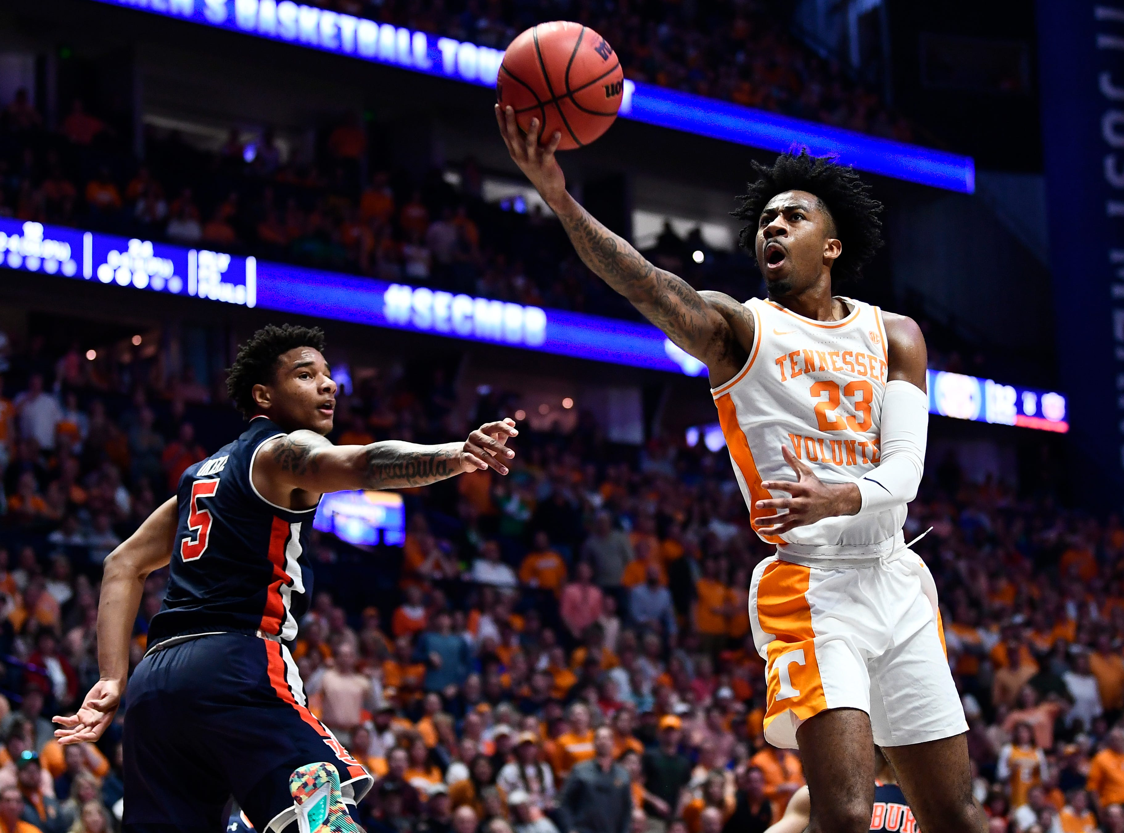 Tennessee guard Jordan Bowden (23) makes a layup in the final seconds of the first half of the SEC Men's Basketball Tournament championship game at Bridgestone Arena in Nashville, Tenn., Sunday, March 17, 2019.