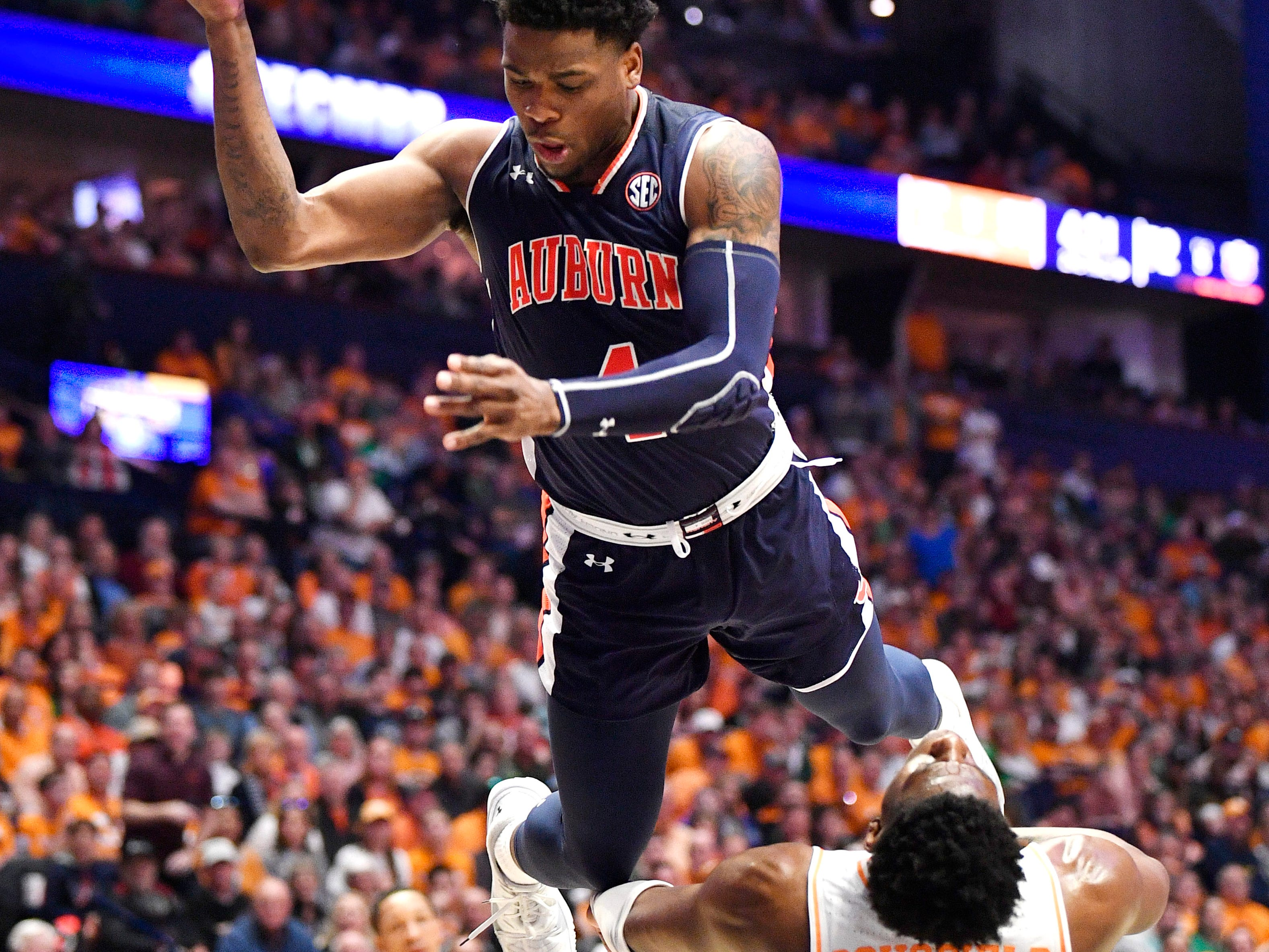 Auburn guard/forward Malik Dunbar (4) shoots over Tennessee guard Admiral Schofield (5) during the second half of the SEC Men's Basketball Tournament championship game at Bridgestone Arena in Nashville, Tenn., Sunday, March 17, 2019.