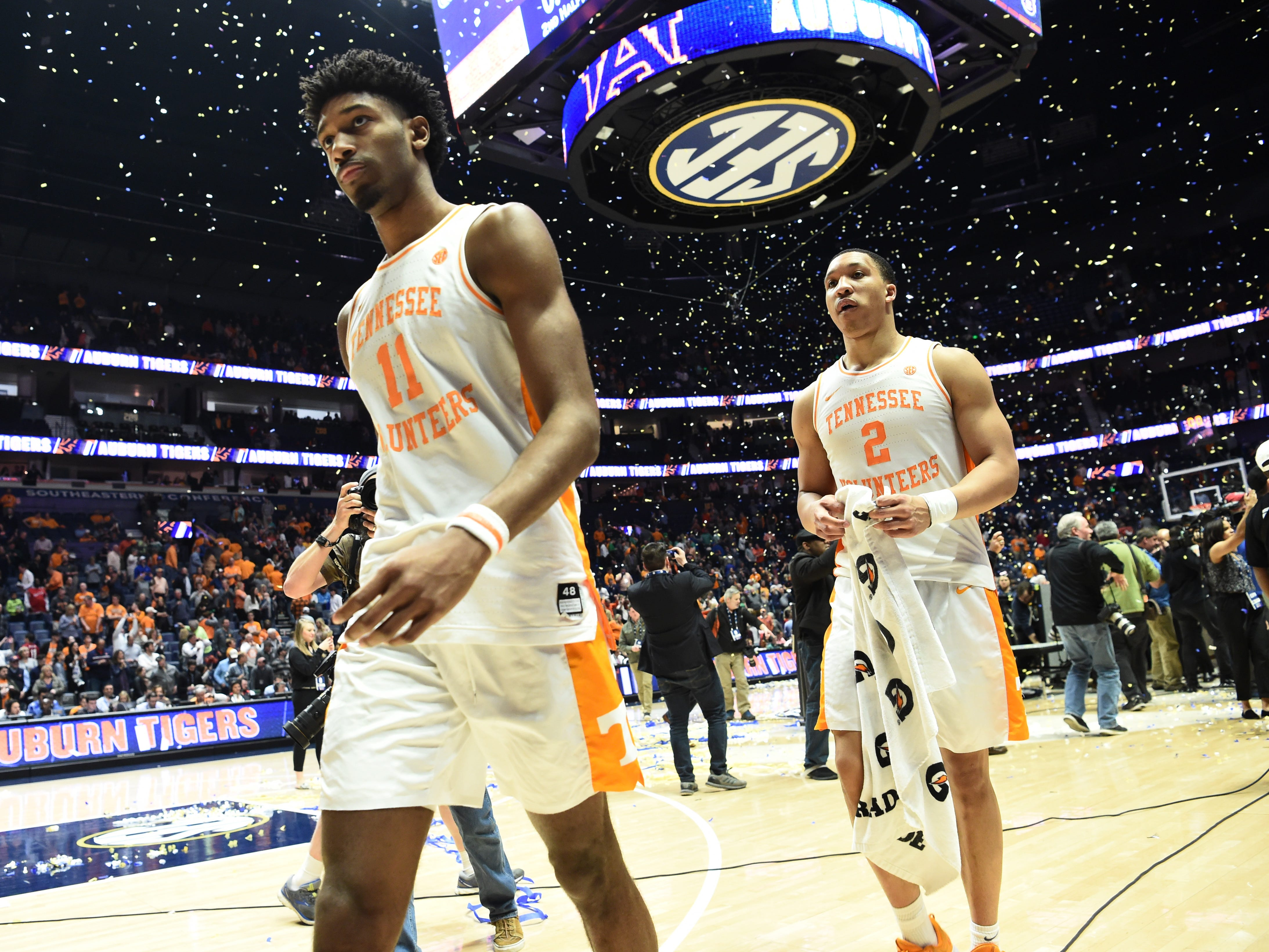 Tennessee forward Kyle Alexander (11) and Tennessee forward Grant Williams (2) walk off the court after the loss to Auburn in the SEC Men's Basketball Tournament championship game at Bridgestone Arena in Nashville, Tenn., Sunday, March 17, 2019.
