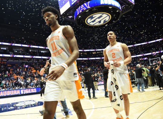 Tennessee's Kyle Alexander (11) and Grant Williams (2) walk off the court after the loss to Auburn on Sunday in the SEC Tournament championship game at Bridgestone Arena.