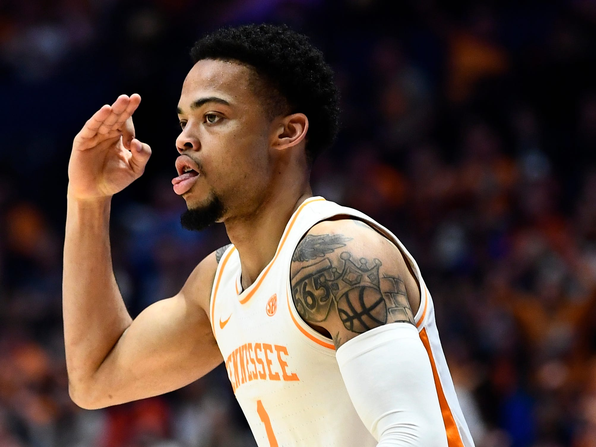 Tennessee guard Lamonte Turner (1) signals a three during the first half of the SEC Men's Basketball Tournament championship game against Auburn at Bridgestone Arena in Nashville, Tenn., Sunday, March 17, 2019.