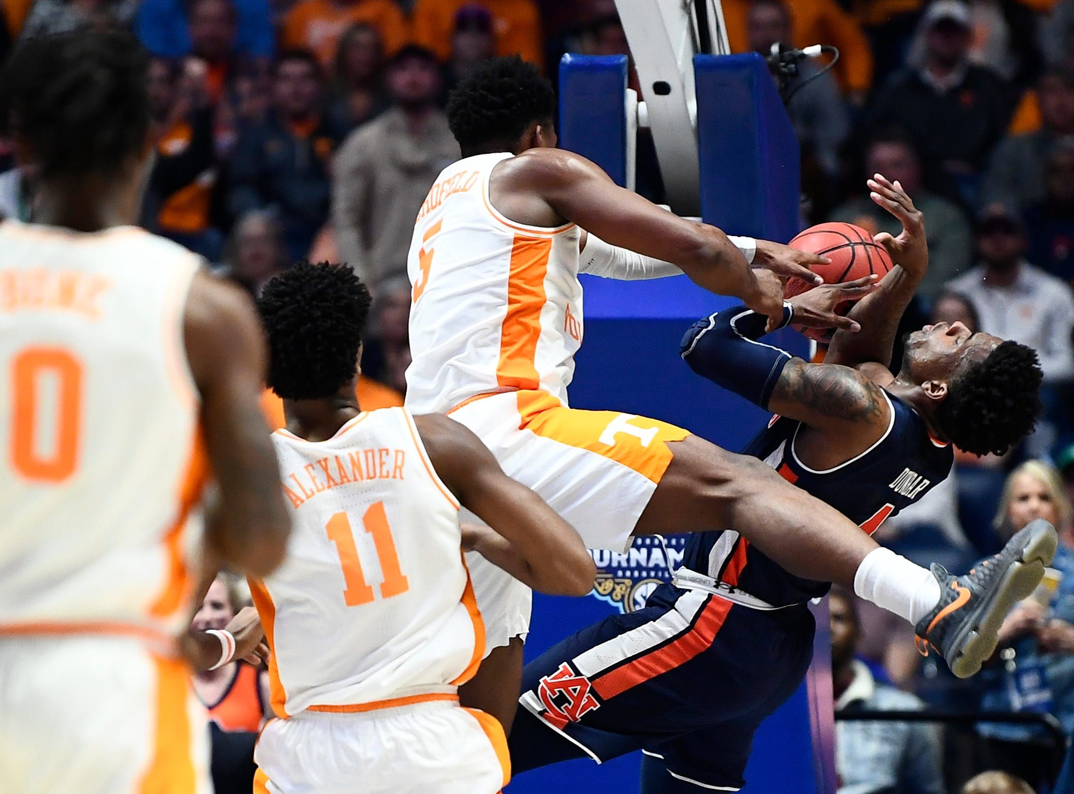 Tennessee guard Admiral Schofield (5) defends Auburn forward Malik Dunbar (4) during the second half of the SEC Men's Basketball Tournament championship game at Bridgestone Arena in Nashville, Tenn., Sunday, March 17, 2019.