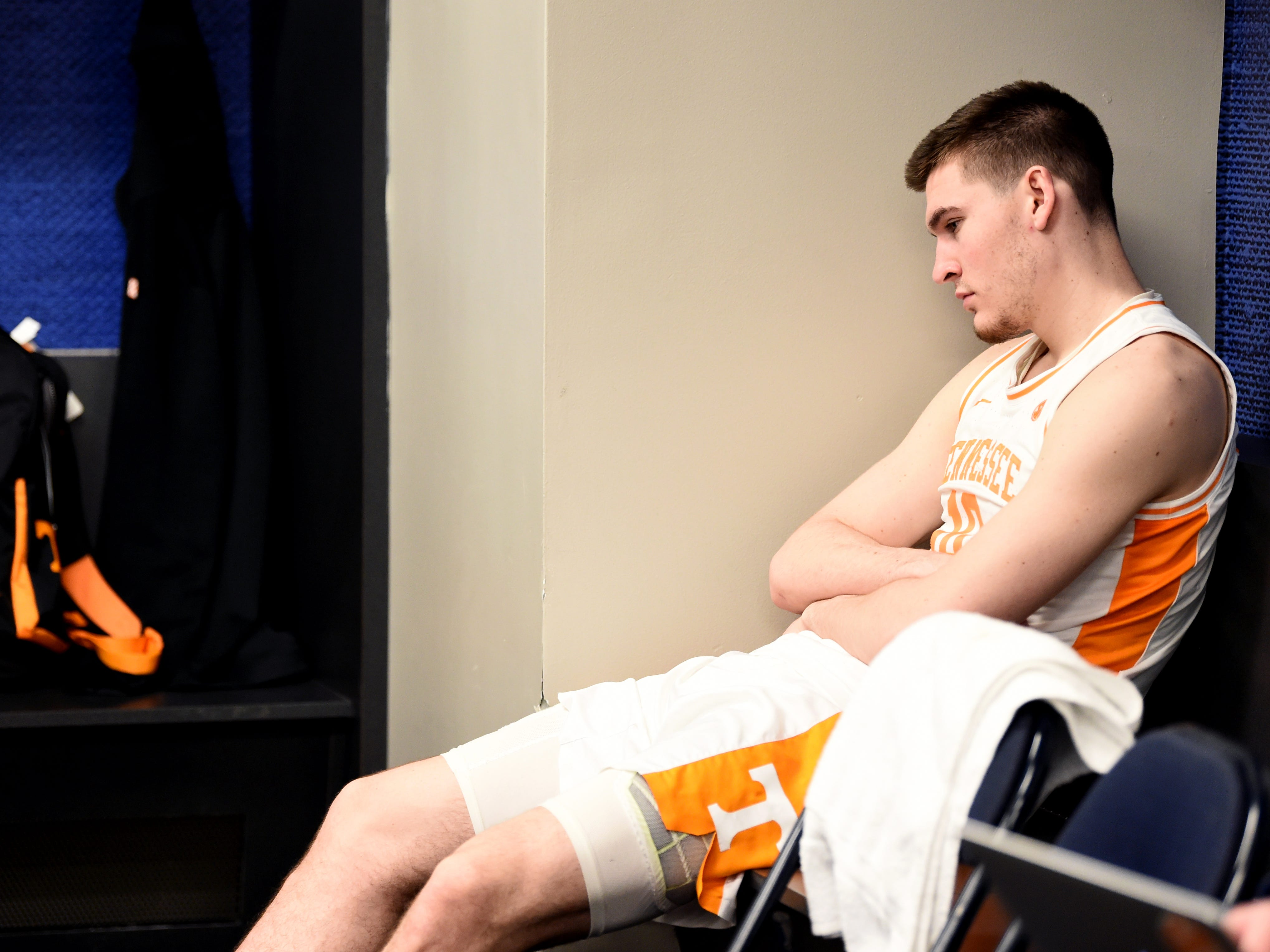 Tennessee forward John Fulkerson (10) sits dejectedly in the locker room following the Vols' 84-64 loss to Auburn in the SEC Tournament Championship held at Bridgestone Arena in Nashville on Sunday, March 17, 2019.