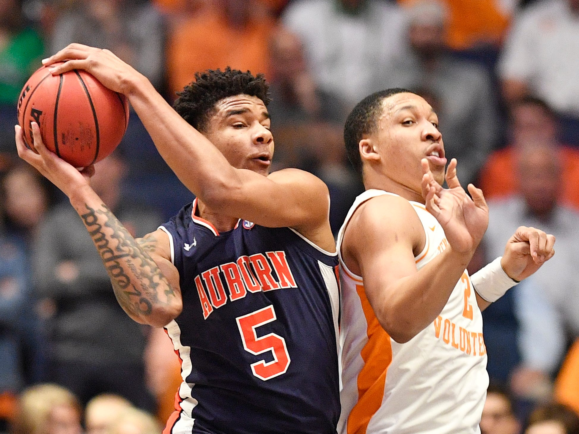 Auburn forward Chuma Okeke (5) grabs a rebound in front of Tennessee forward Grant Williams (2) during the first half of the SEC Men's Basketball Tournament championship game at Bridgestone Arena in Nashville, Tenn., Sunday, March 17, 2019.