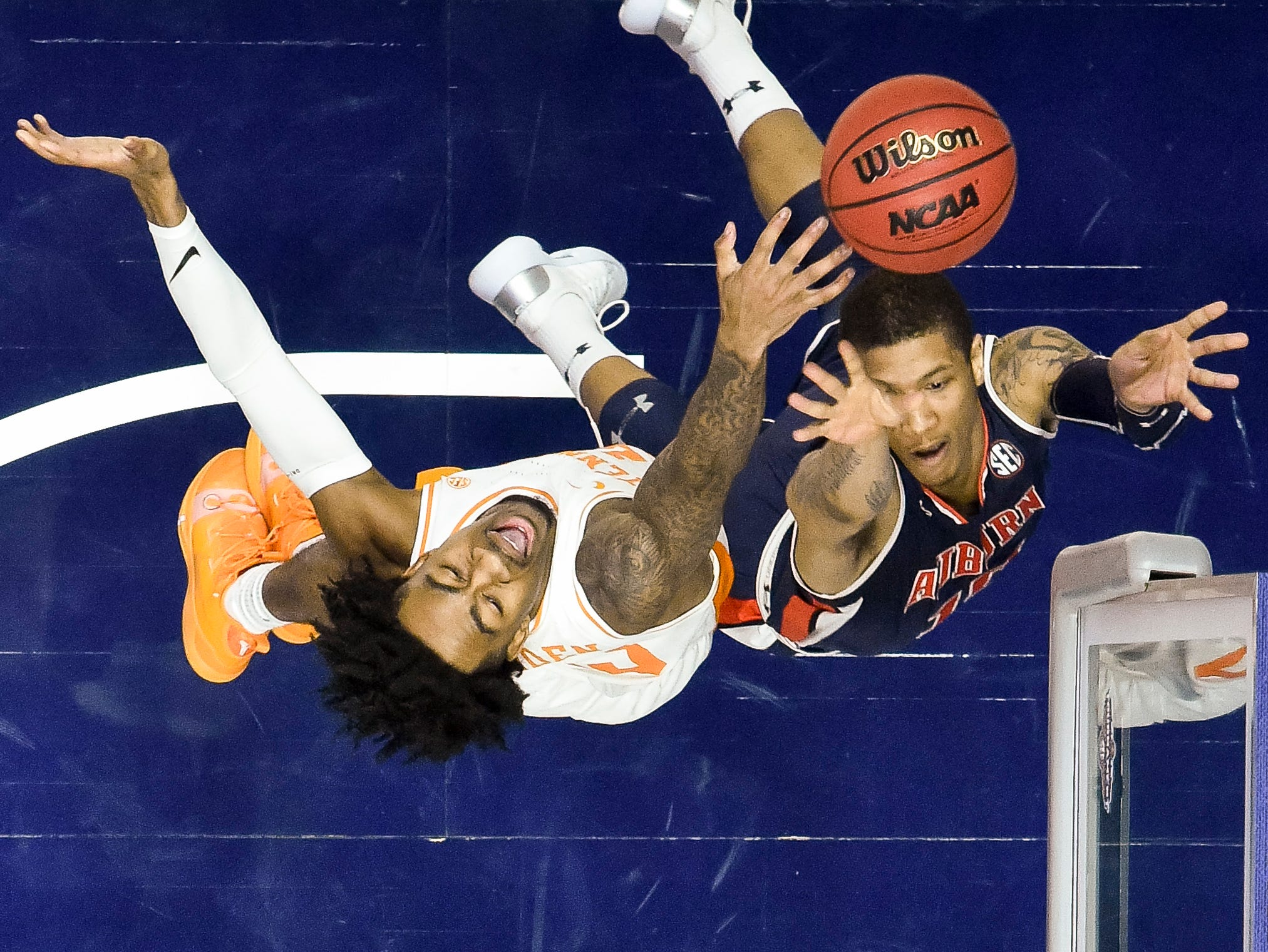 Auburn guard Samir Doughty (10) battles Tennessee guard Jordan Bowden (23) during the second half of the SEC Men's Basketball Tournament championship game at Bridgestone Arena in Nashville, Tenn., Sunday, March 17, 2019.