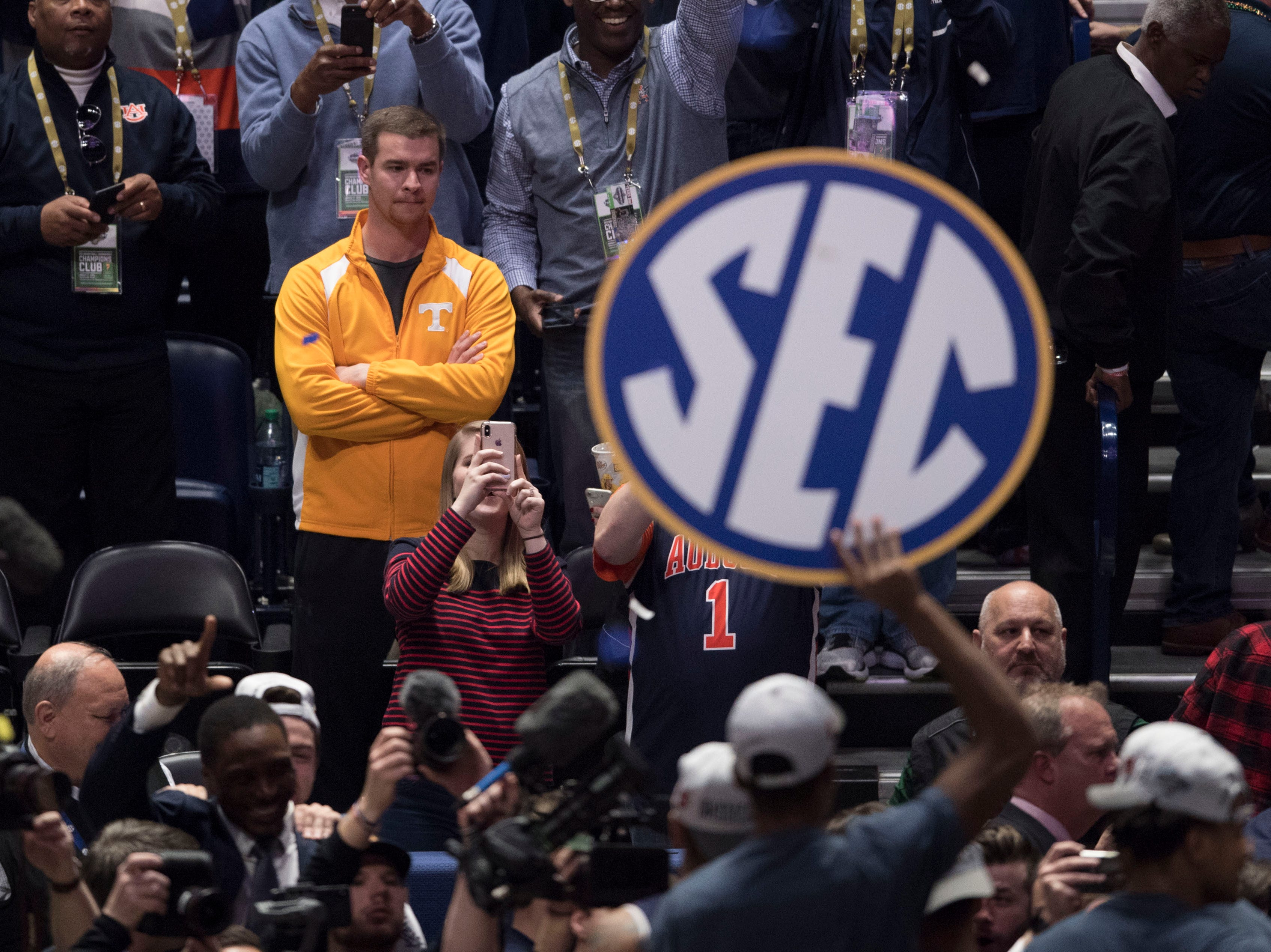 A Tennessee fan watches on as Auburn celebrates after the SEC Men's Basketball Tournament championship game at Bridgestone Arena in Nashville, Tenn., Sunday, March 17, 2019.