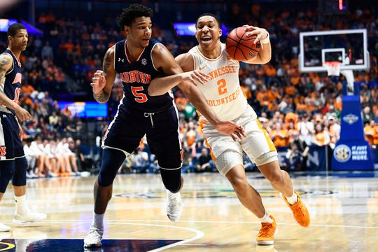 Tennessee forward Grant Williams (2) drives towards the basket while defended by Auburn forward Chuma Okeke (5) during the first half of the SEC Men's Basketball Tournament championship game at Bridgestone Arena in Nashville, Tenn., Sunday, March 17, 2019.