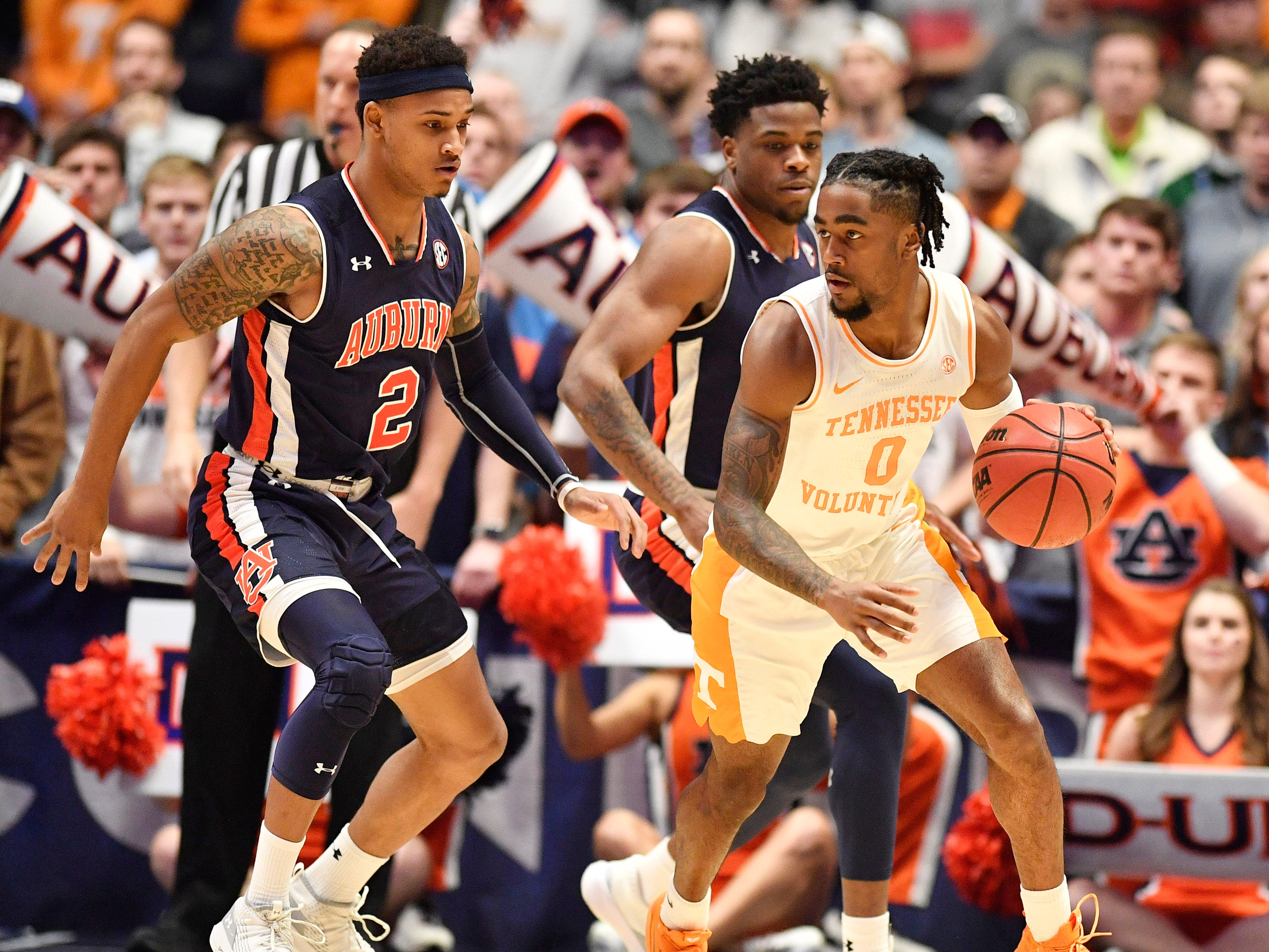 Tennessee guard Jordan Bone (0) moves the ball defended by Auburn guard Bryce Brown (2) during the first half of the SEC Men's Basketball Tournament championship game at Bridgestone Arena in Nashville, Tenn., Sunday, March 17, 2019.