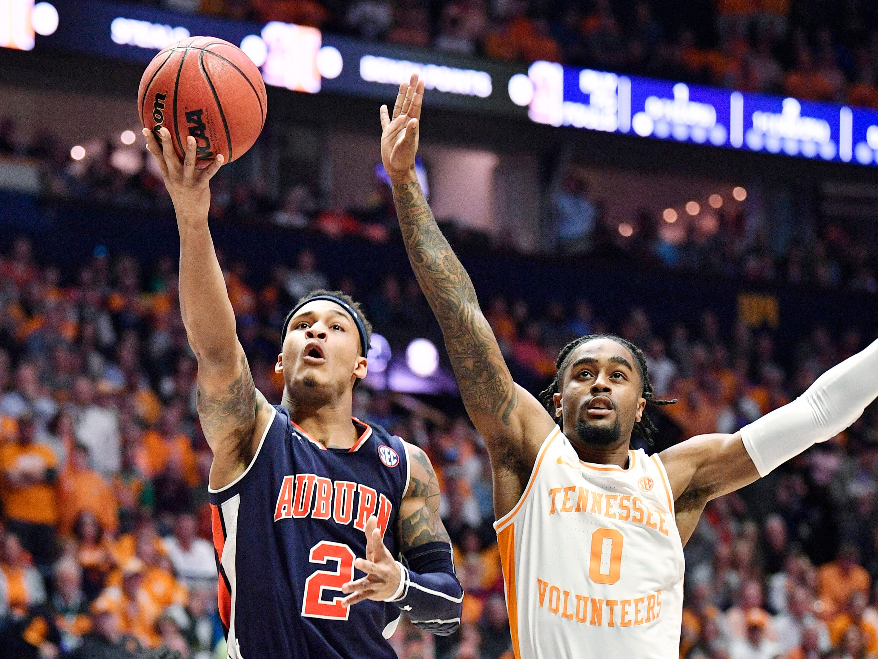 Auburn guard Bryce Brown (2) goes to the basket defended by Tennessee guard Jordan Bone (0) during the firsthalf of the SEC Men's Basketball Tournament championship game at Bridgestone Arena in Nashville, Tenn., Sunday, March 17, 2019.