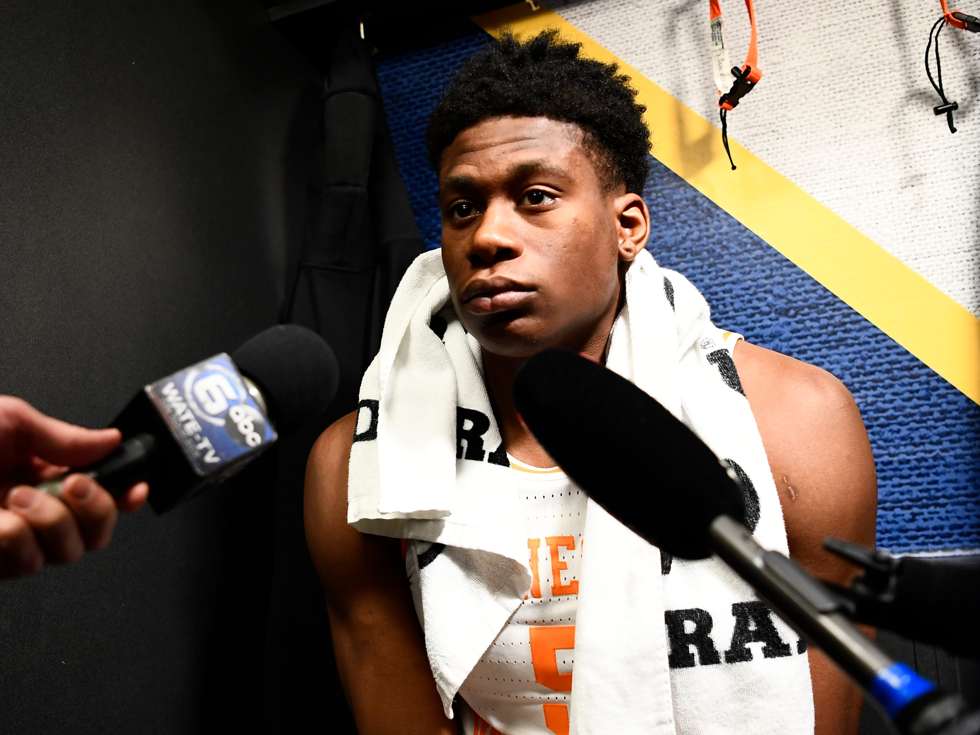 Tennessee guard Admiral Schofield (5) speaks with the media in the locker room following the Vols' 84-64 loss to Auburn in the SEC Tournament Championship held at Bridgestone Arena in Nashville on Sunday, March 17, 2019.