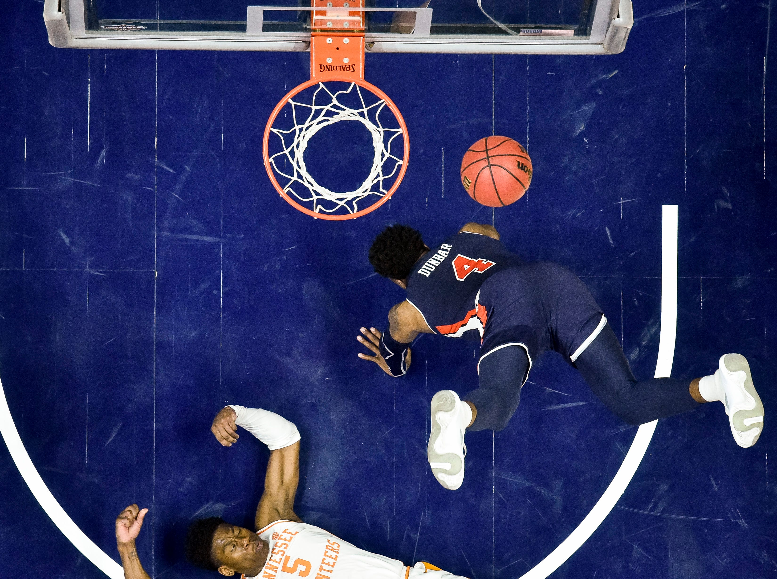 Tennessee guard Admiral Schofield (5) fouls Auburn guard/forward Malik Dunbar (4) during the second half of the SEC Men's Basketball Tournament championship game at Bridgestone Arena in Nashville, Tenn., Sunday, March 17, 2019.