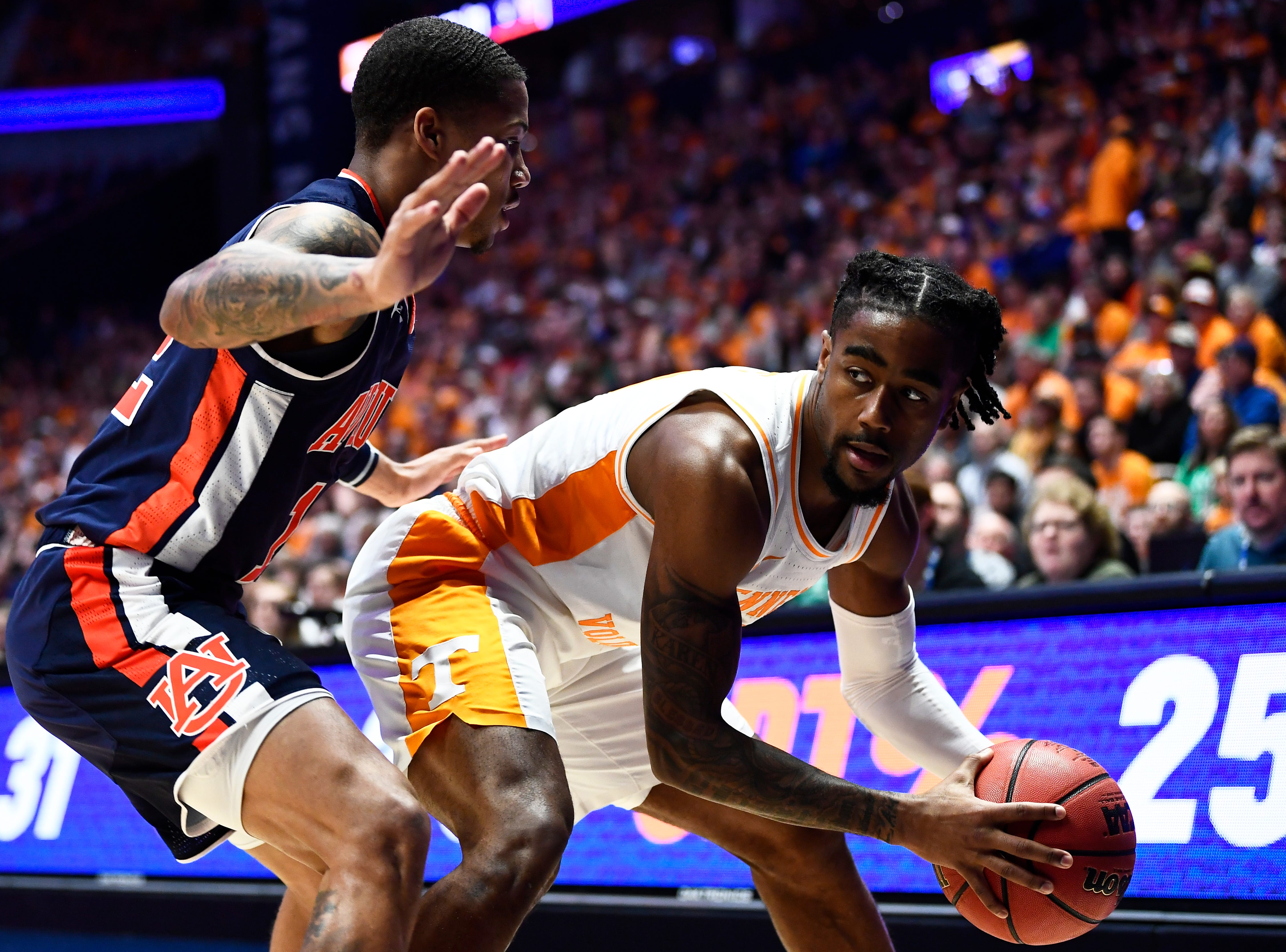 Tennessee guard Jordan Bone is defended by an Auburn player during the first half of the SEC Men's Basketball Tournament championship game at Bridgestone Arena in Nashville, Tenn., Sunday, March 17, 2019.