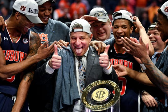 Auburn head coach Bruce Pearl celebrates with his team after their SEC Men's Basketball Tournament championship victory against Tennessee at Bridgestone Arena in Nashville, Tenn., Sunday, March 17, 2019.