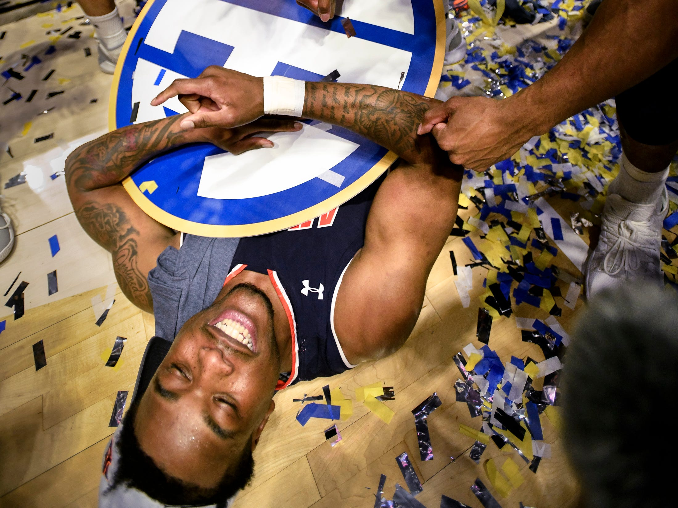 Auburn guard/forward Malik Dunbar (4) celebrates after their SEC Men's Basketball Tournament championship victory against Tennessee at Bridgestone Arena in Nashville, Tenn., Sunday, March 17, 2019.