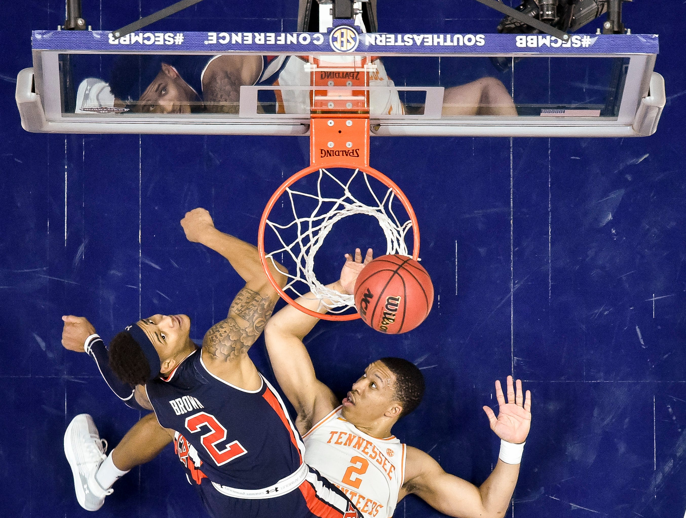 Auburn guard Bryce Brown (2) watches his shot miss the net over Tennessee forward Grant Williams (2) during the second half of the SEC Men's Basketball Tournament championship game at Bridgestone Arena in Nashville, Tenn., Sunday, March 17, 2019.