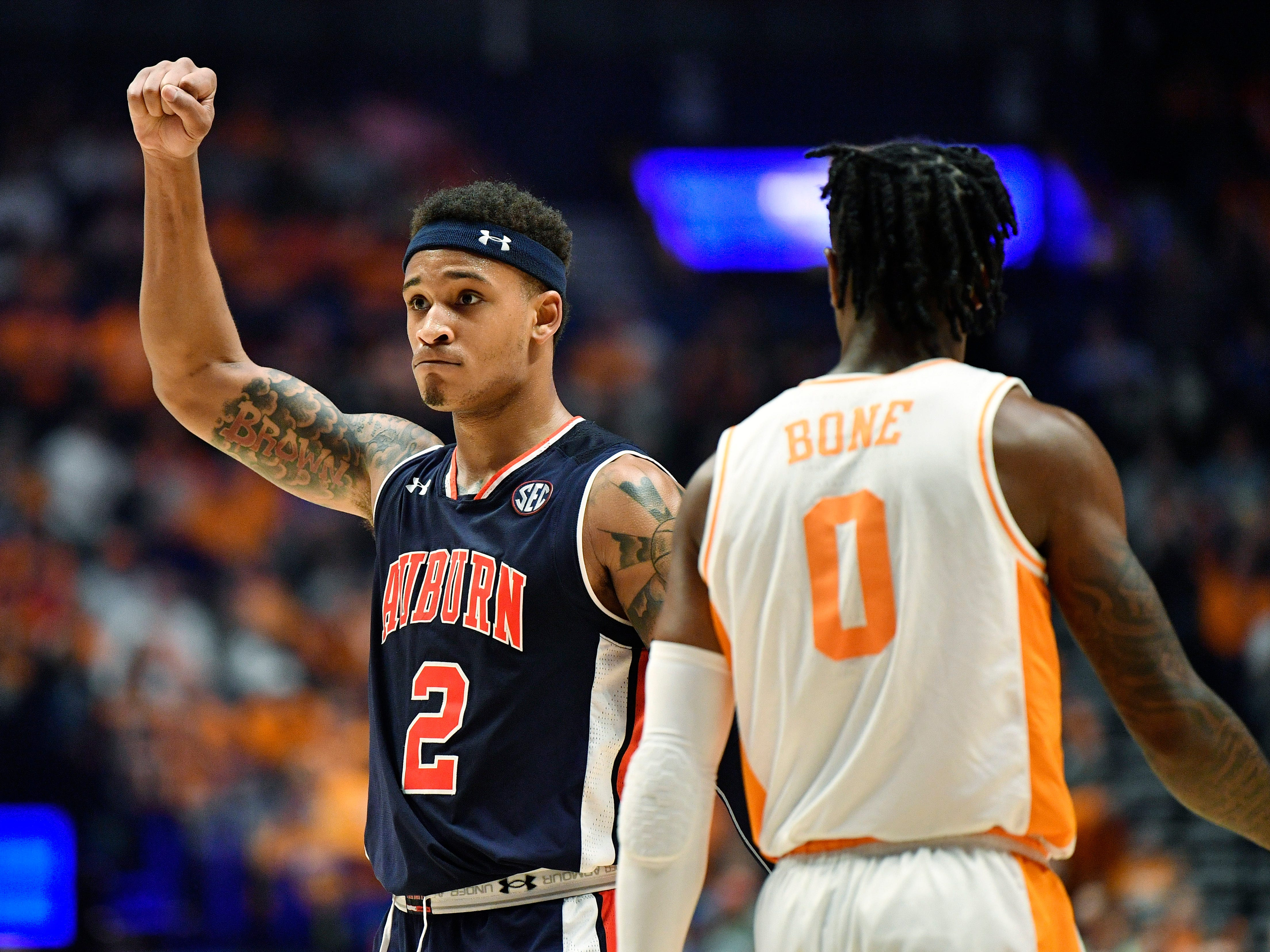 Auburn guard Bryce Brown (2) reacts as Tennessee guard Jordan Bone (0) walks by during the second half of the SEC Men's Basketball Tournament championship game at Bridgestone Arena in Nashville, Tenn., Sunday, March 17, 2019.