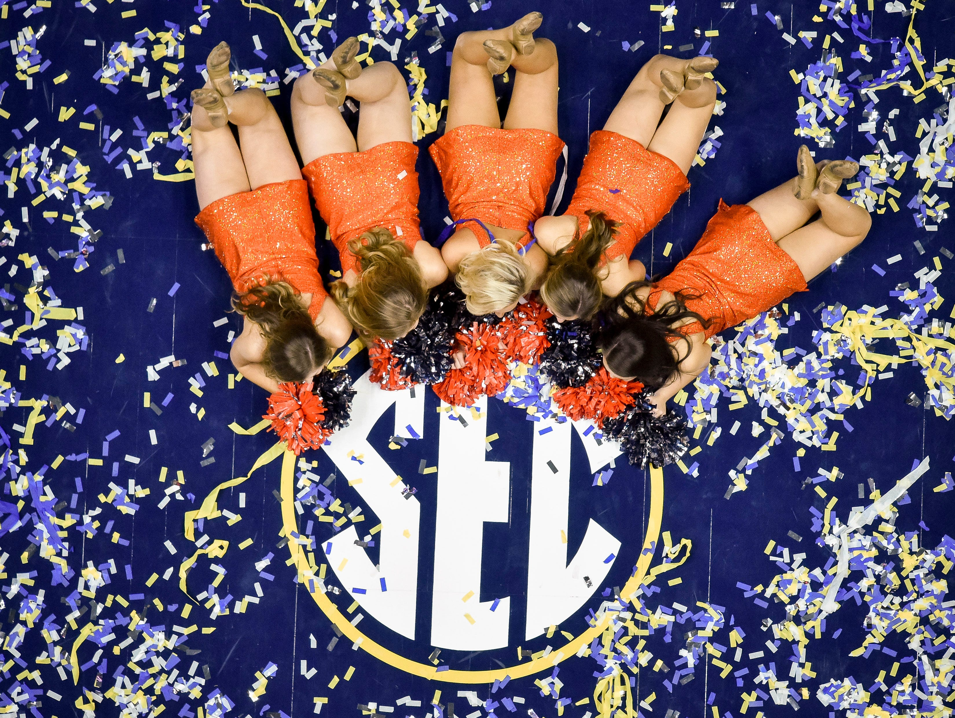 The Auburn University Tiger Paws celebrate after Auburn's SEC Men's Basketball Tournament championship victory against Tennessee at Bridgestone Arena in Nashville, Tenn., Sunday, March 17, 2019.