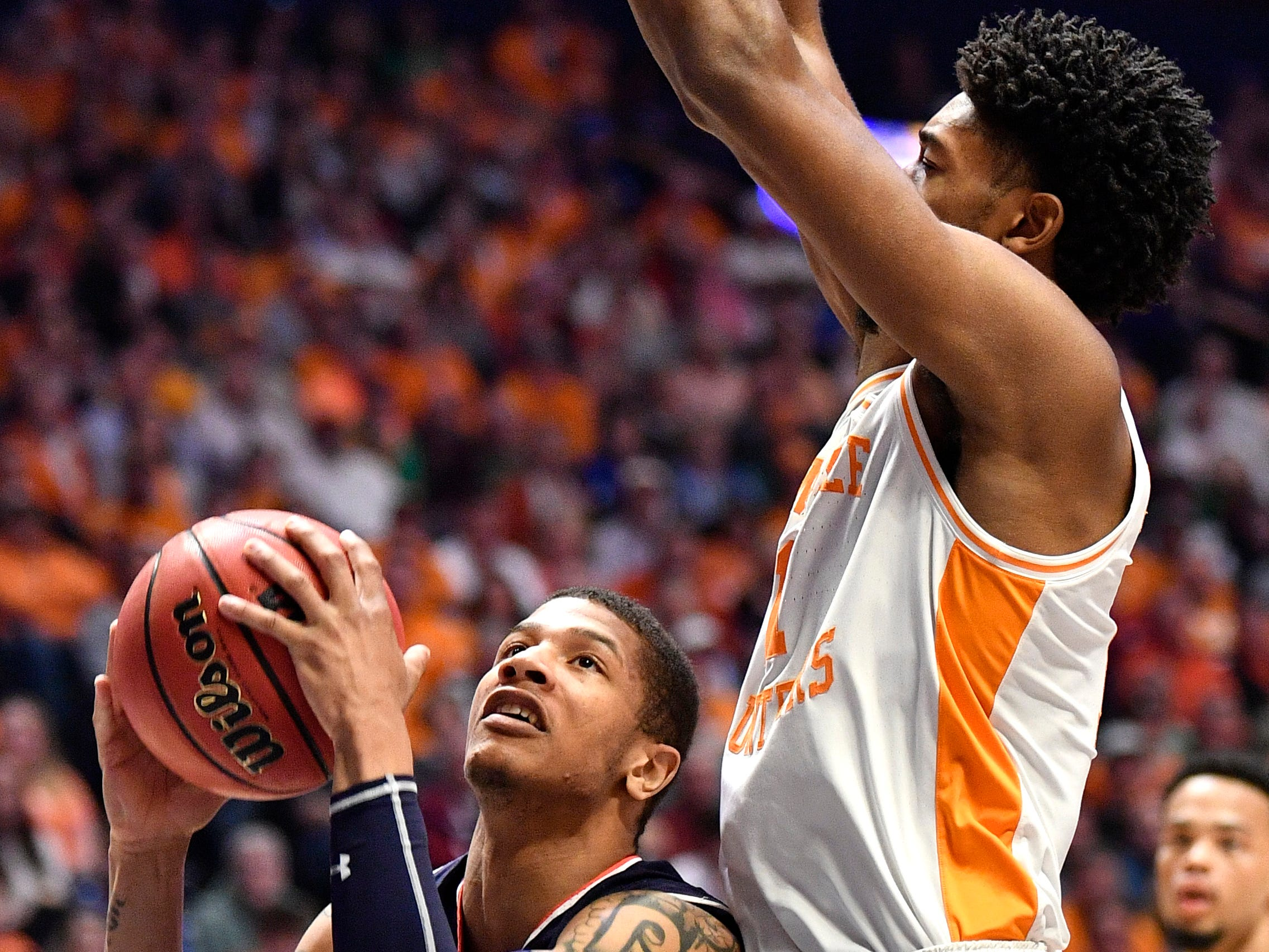 Auburn guard Samir Doughty (10) tries to shoot defended by Tennessee forward Kyle Alexander (11) during the first half of the SEC Men's Basketball Tournament championship game at Bridgestone Arena in Nashville, Tenn., Sunday, March 17, 2019.