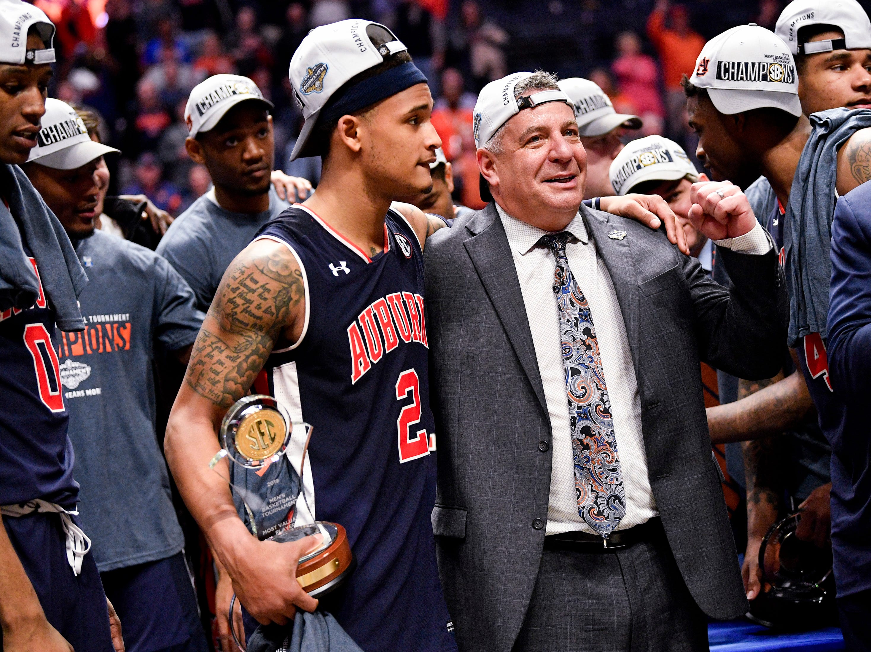 Auburn guard Bryce Brown (2) and head coach Bruce Pearl celebrate after their SEC Men's Basketball Tournament championship victory against Tennessee at Bridgestone Arena in Nashville, Tenn., Sunday, March 17, 2019.