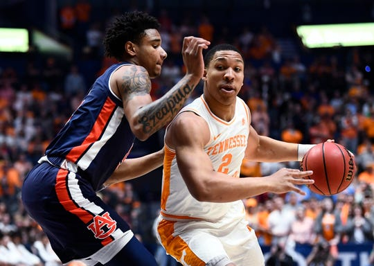 Tennessee forward Grant Williams (2) moves the ball defended by Auburn forward Chuma Okeke (5) during the first half of the SEC Men's Basketball Tournament championship game at Bridgestone Arena in Nashville, Tenn., Sunday, March 17, 2019.