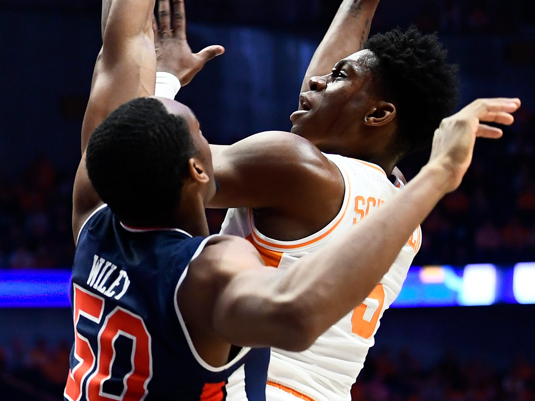 Tennessee guard Admiral Schofield (5) takes a shot while defended by Auburn center Austin Wiley (50) during the first half of the SEC Men's Basketball Tournament championship game at Bridgestone Arena in Nashville, Tenn., Sunday, March 17, 2019.