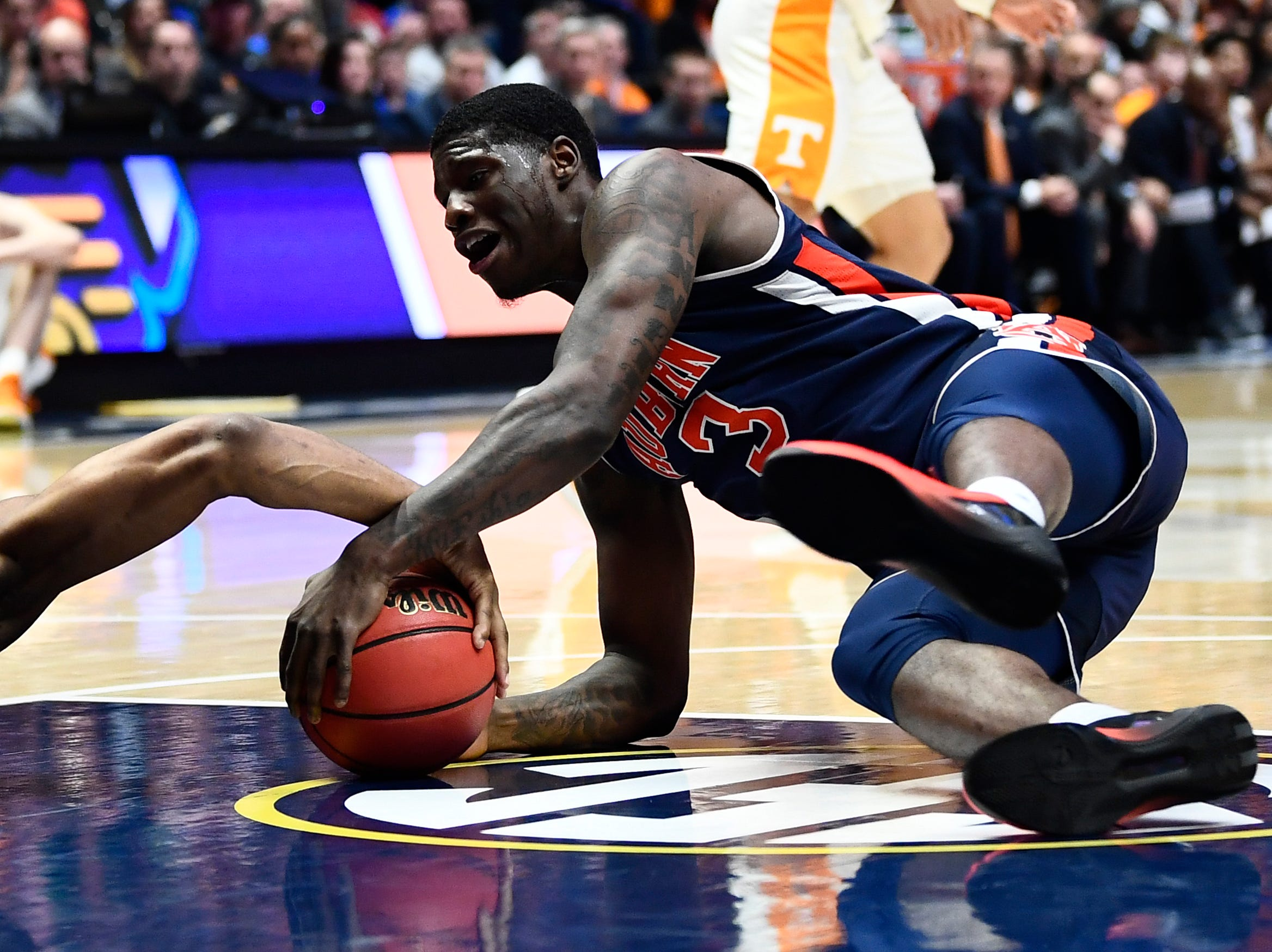 Auburn forward Danjel Purifoy (3) and a teammate fight for a loose ball after a Tennessee turnover during the first half of the SEC Men's Basketball Tournament championship game at Bridgestone Arena in Nashville, Tenn., Sunday, March 17, 2019.
