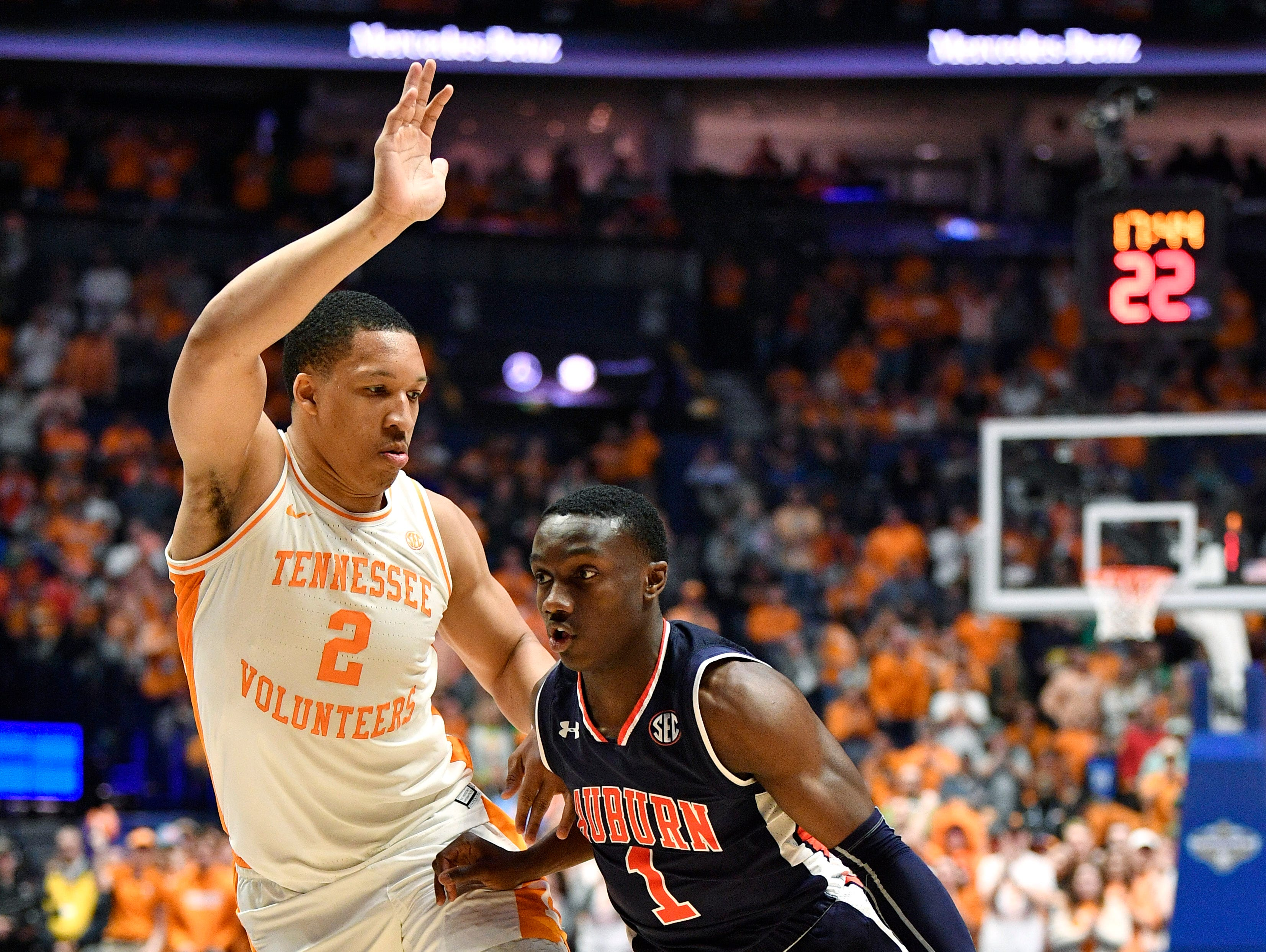 Auburn guard Jared Harper (1) drives to the basket defended by Tennessee forward Grant Williams (2) during the second half of the SEC Men's Basketball Tournament championship game at Bridgestone Arena in Nashville, Tenn., Sunday, March 17, 2019.