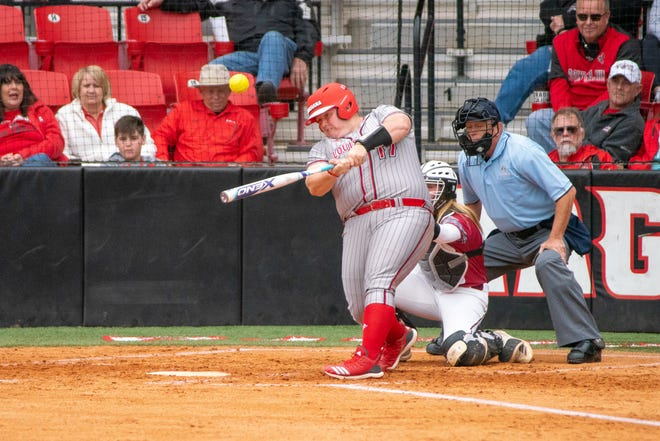 UL's Bailey Curry makes contact Sunday during the Ragin' Cajuns' 8-0 victory over Troy at Yvette Girouard Field at Lamson Park.