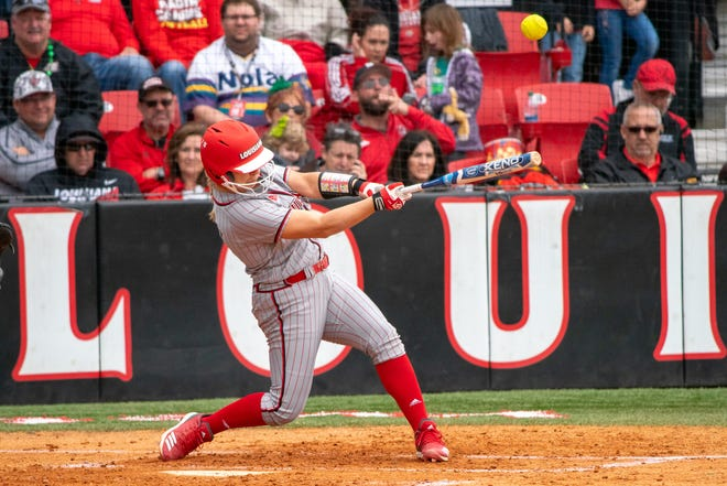 UL's Lexie Comeaux connects with the pitch as the Ragin' Cajuns take on the Troy Trojans at Yvette Girouard Field on March 17, 2019.