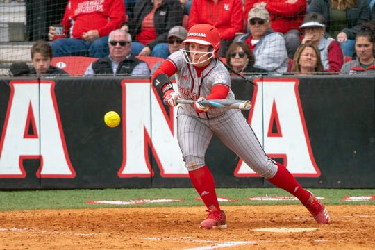 UL's Kourtney Gremillion bunts the ball as the Ragin' Cajuns take on the Troy Trojans at Yvette Girouard Field on March 17, 2019.