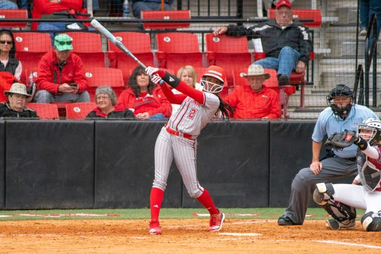UL's Raina O'Neal watches the ball after her hit as the Ragin' Cajuns take on the Troy Trojans at Yvette Girouard Field on March 17, 2019.