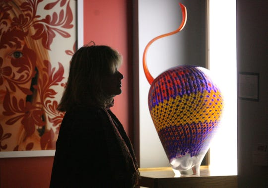 "In this file photo, Melanie Walker looked at Stephen Rolfe Powell's ""Zealous Hyper Glare"" glasswork at St. Francis School in 2008."