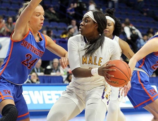 Male's Joelle Johnson, right, looks for an opening on Southwestern's Kallie Sheron  in their semifinal game at the KHSAA Girl's Sweet 16, Saturday, March 16.