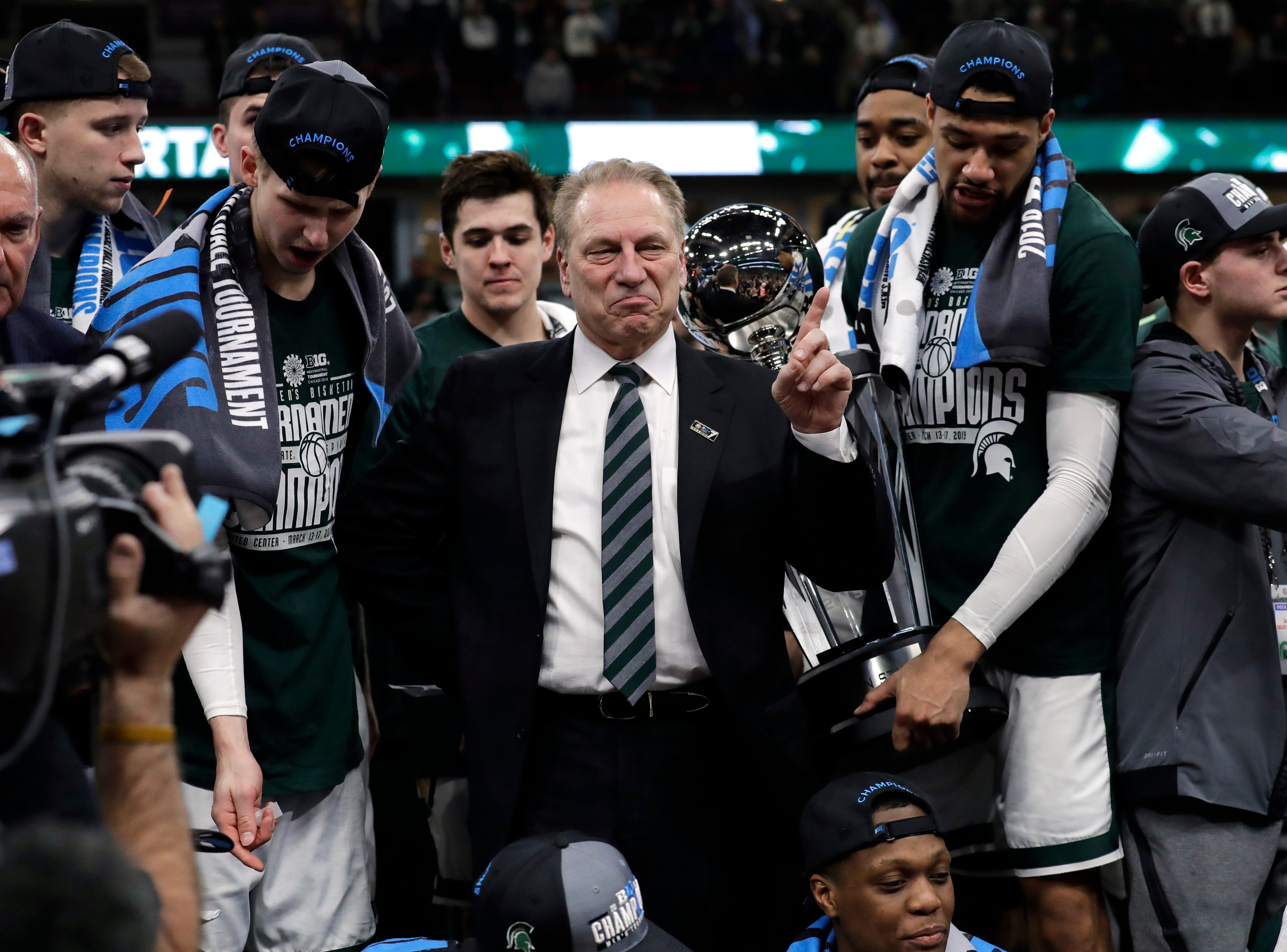 Michigan State head coach Tom Izzo celebrates with his team after defeating Michigan 65-60 in an NCAA college basketball championship game in the Big Ten Conference tournament, Sunday, March 17, 2019, in Chicago. (AP Photo/Nam Y. Huh)