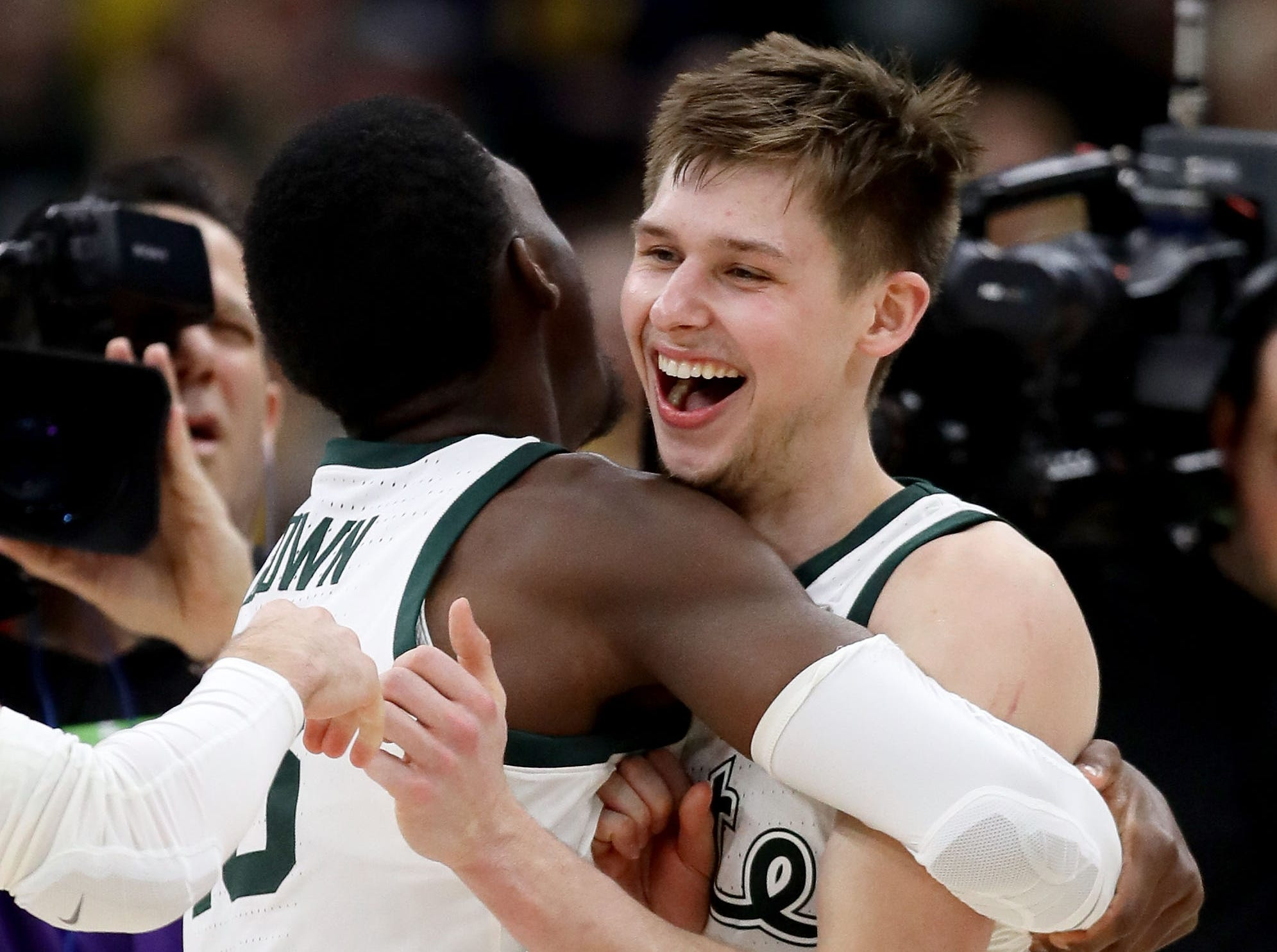 CHICAGO, ILLINOIS - MARCH 17:  Gabe Brown #13 and Matt McQuaid #20 of the Michigan State Spartans celebrate after beating the Michigan Wolverines 65-60 in the championship game of the Big Ten Basketball Tournament at the United Center on March 17, 2019 in Chicago, Illinois. (Photo by Jonathan Daniel/Getty Images)