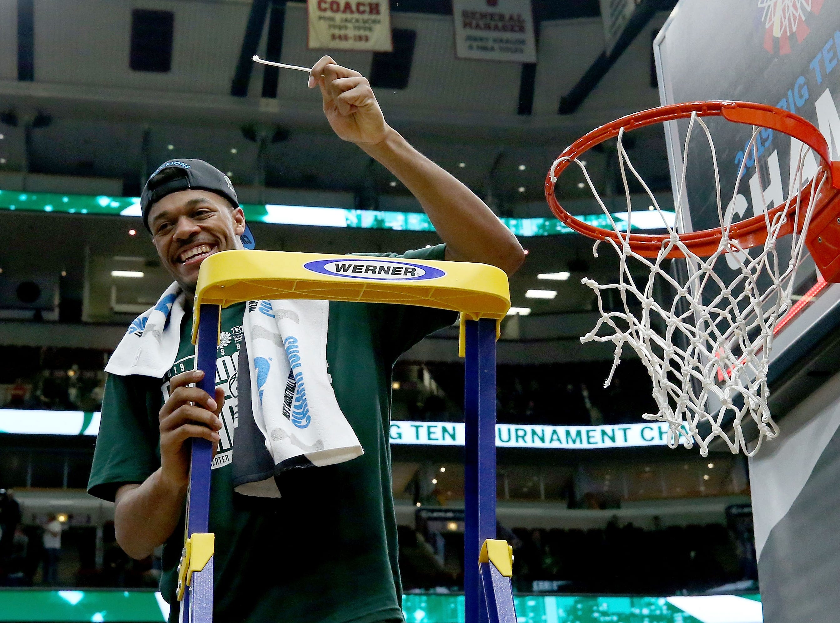 CHICAGO, ILLINOIS - MARCH 17:  Xavier Tillman #23 of the Michigan State Spartans cuts down the net after beating the Michigan Wolverines 65-60 in the championship game of the Big Ten Basketball Tournament at the United Center on March 17, 2019 in Chicago, Illinois. (Photo by Jonathan Daniel/Getty Images)