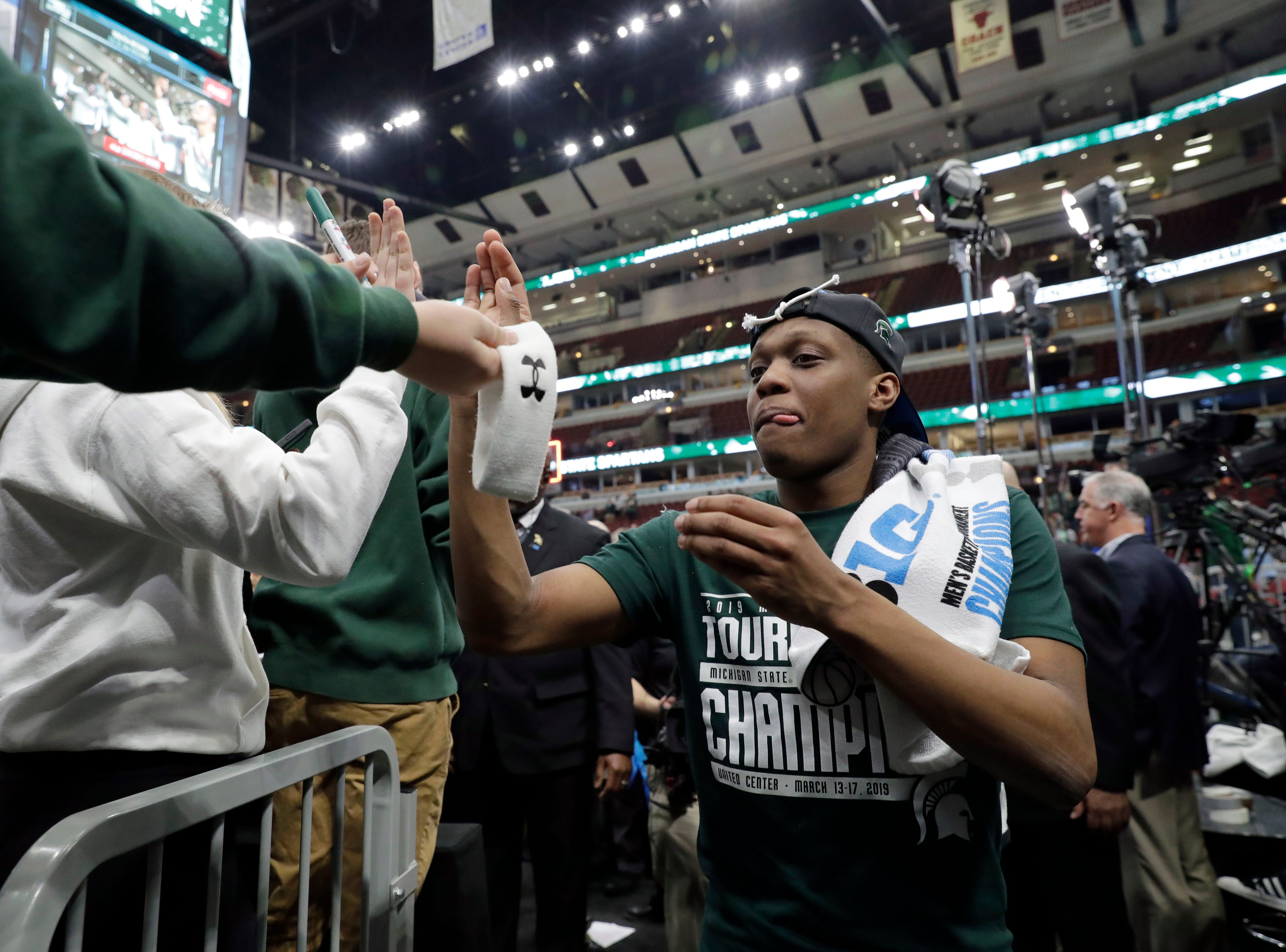 Michigan State's Cassius Winston celebrates after defeating Michigan 65-60 in an NCAA college basketball championship game in the Big Ten Conference tournament, Sunday, March 17, 2019, in Chicago. (AP Photo/Nam Y. Huh)
