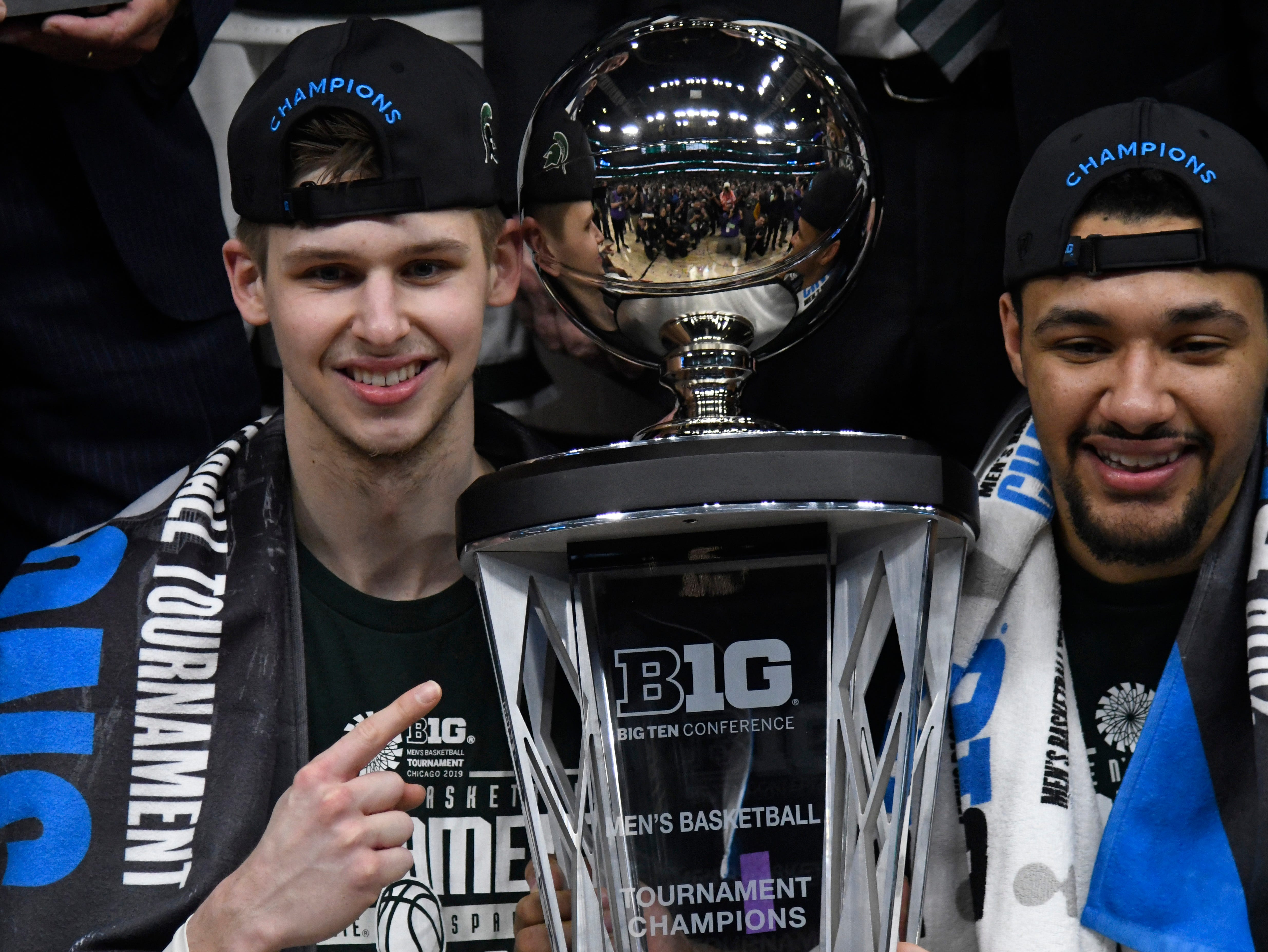 Mar 17, 2019; Chicago, IL, USA; Michigan State Spartans guard Matt McQuaid (left) and forward Kenny Goins (right) celebrate their Big Ten championship in the Big Ten conference tournament at United Center. Mandatory Credit: David Banks-USA TODAY Sports