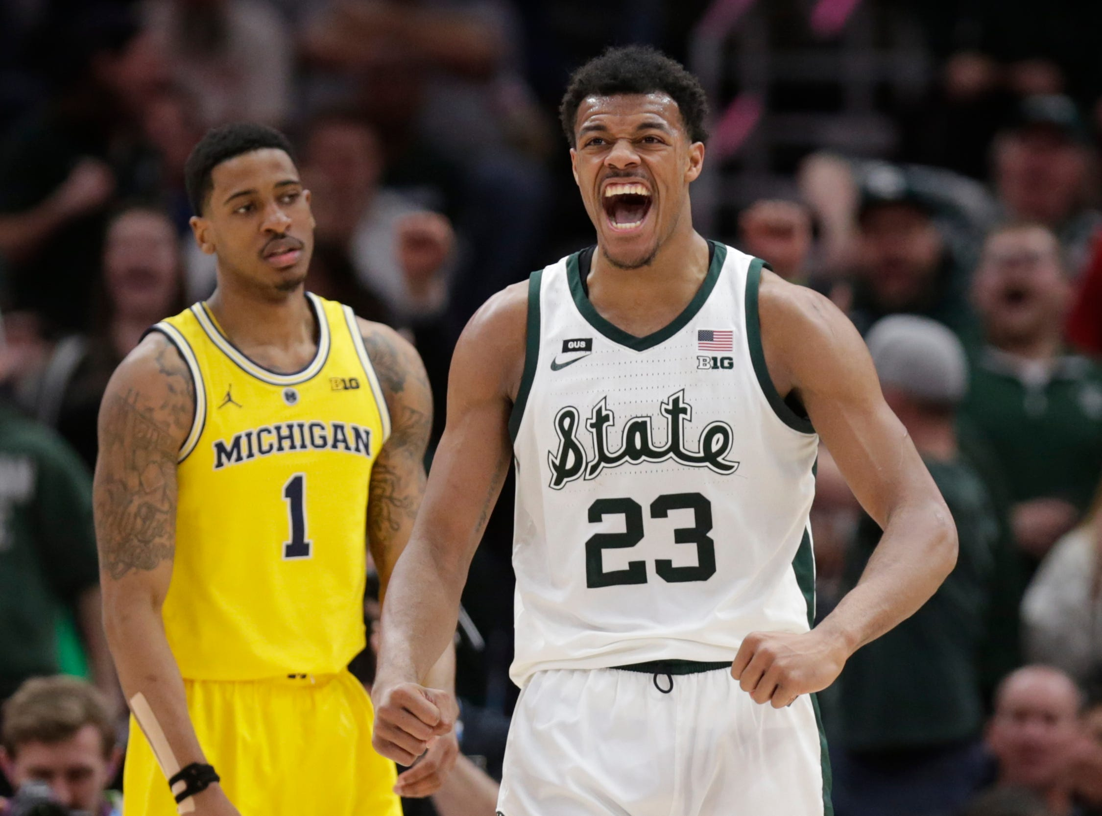 Michigan State's Xavier Tillman (23) reacts during the second half of an NCAA college basketball championship game against Michigan in the Big Ten Conference tournament, Sunday, March 17, 2019, in Chicago.