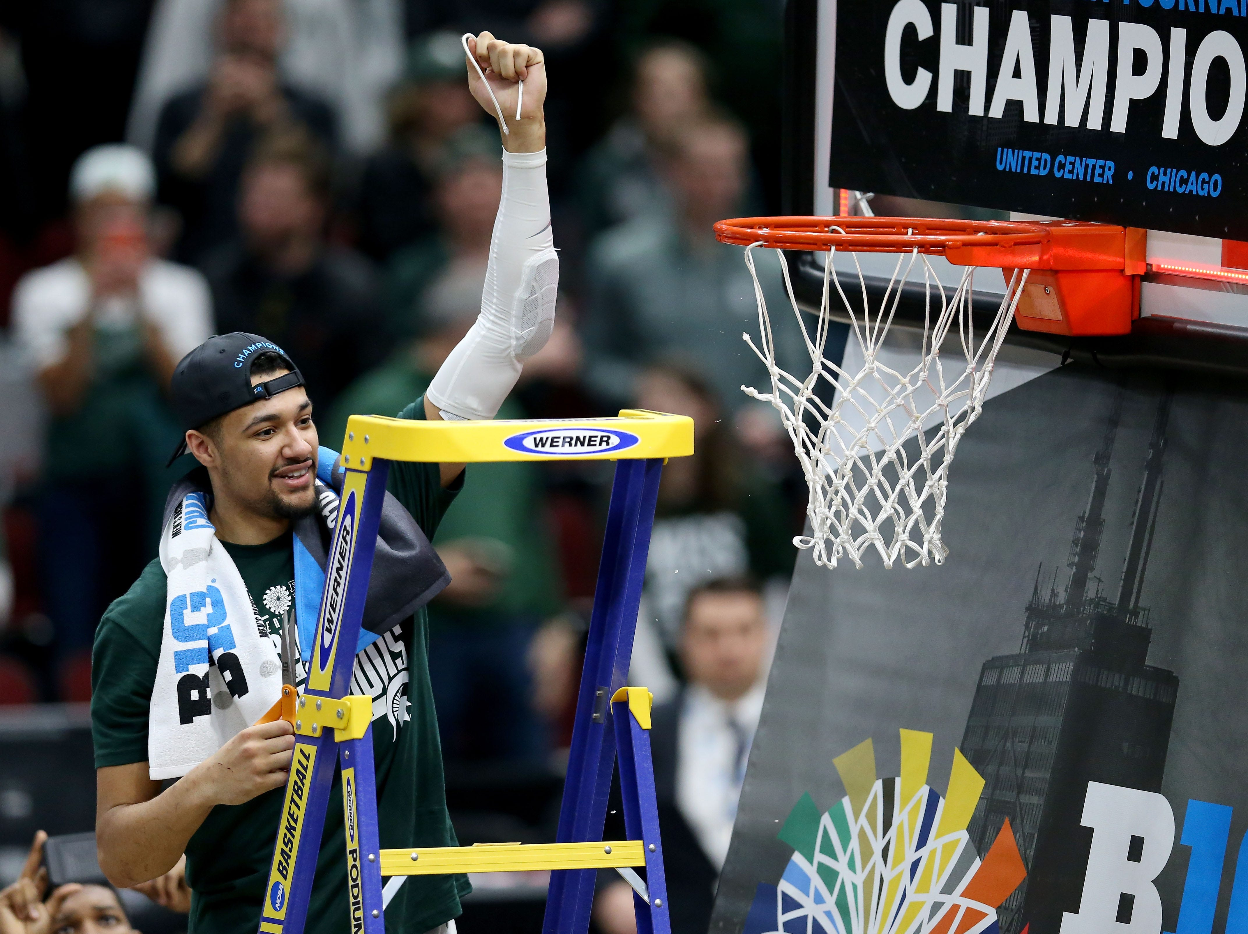 CHICAGO, ILLINOIS - MARCH 17:  Kenny Goins #25 of the Michigan State Spartans cuts down the net after beating the Michigan Wolverines 65-60 in the championship game of the Big Ten Basketball Tournament at the United Center on March 17, 2019 in Chicago, Illinois. (Photo by Dylan Buell/Getty Images)