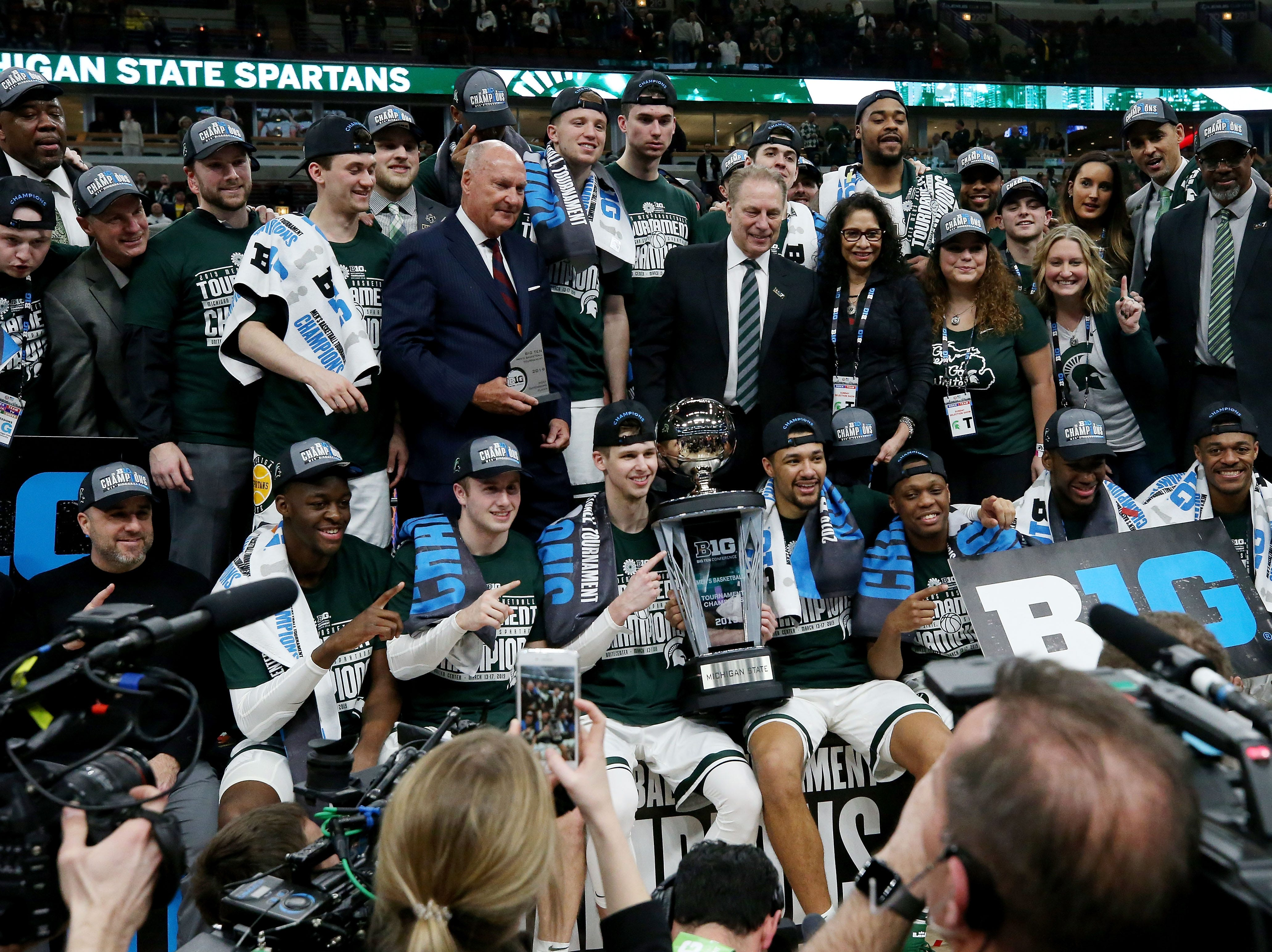 CHICAGO, ILLINOIS - MARCH 17:  The Michigan State Spartans pose for photos after beating the Michigan Wolverines 65-60 in the championship game of the Big Ten Basketball Tournament at the United Center on March 17, 2019 in Chicago, Illinois. (Photo by Jonathan Daniel/Getty Images)